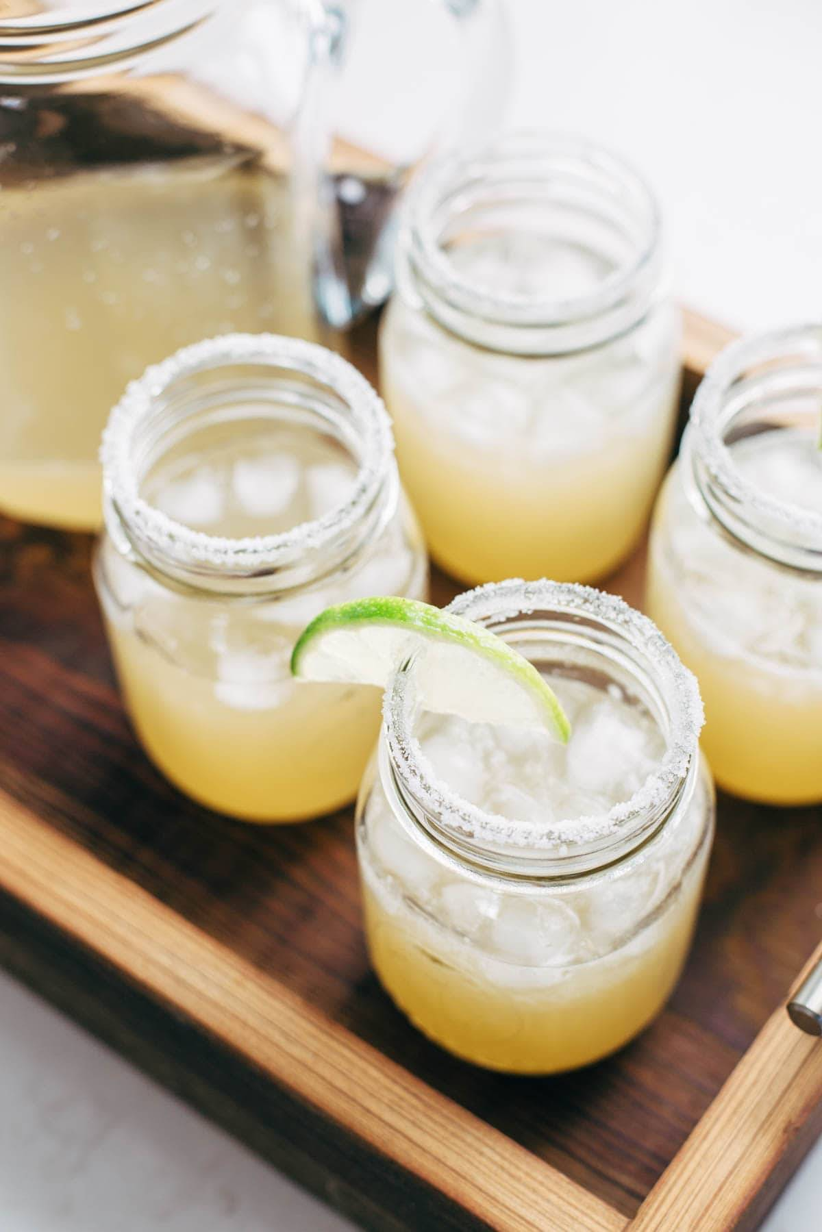 Pitcher style margaritas for a crowd recipe pinch of yum margaritas in jars with a lime slice forumfinder Gallery