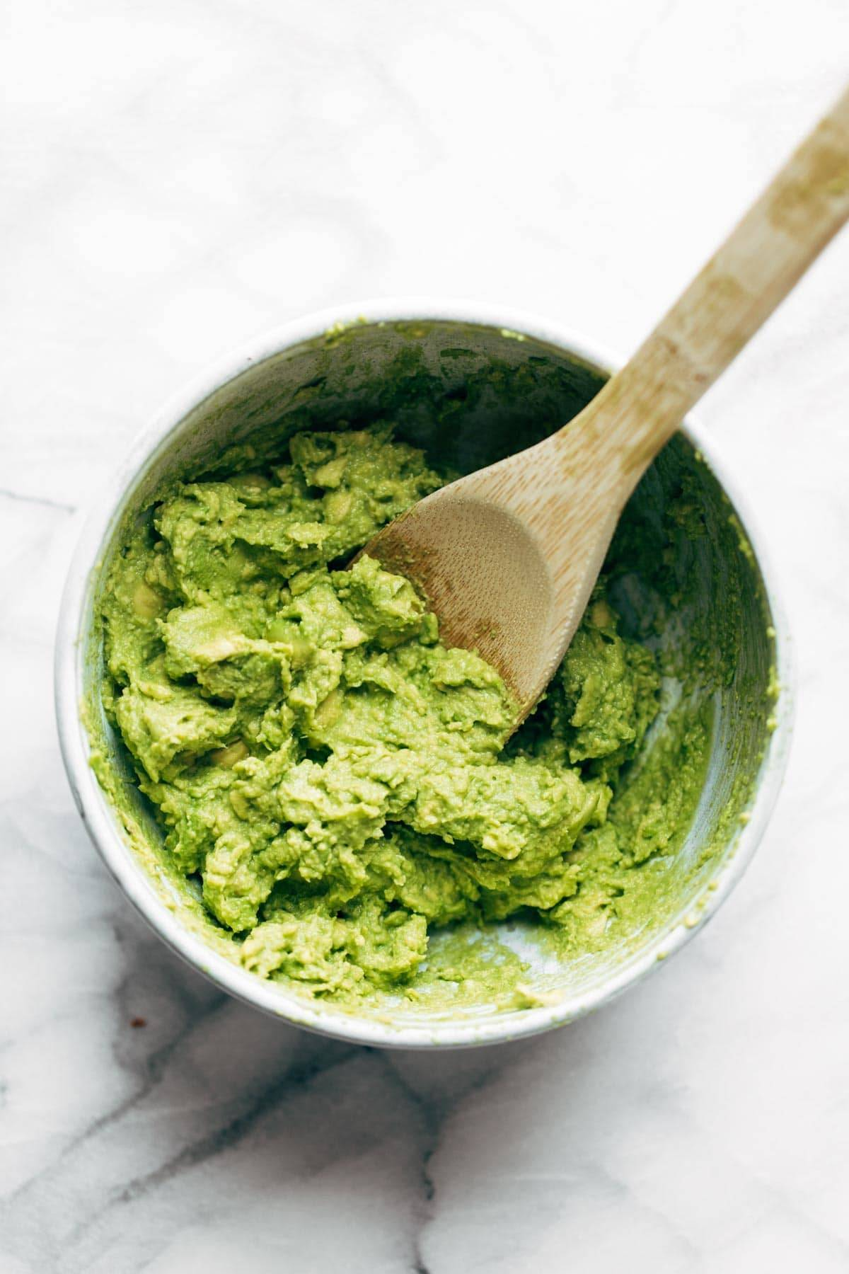 Avocado mashed in a bowl.
