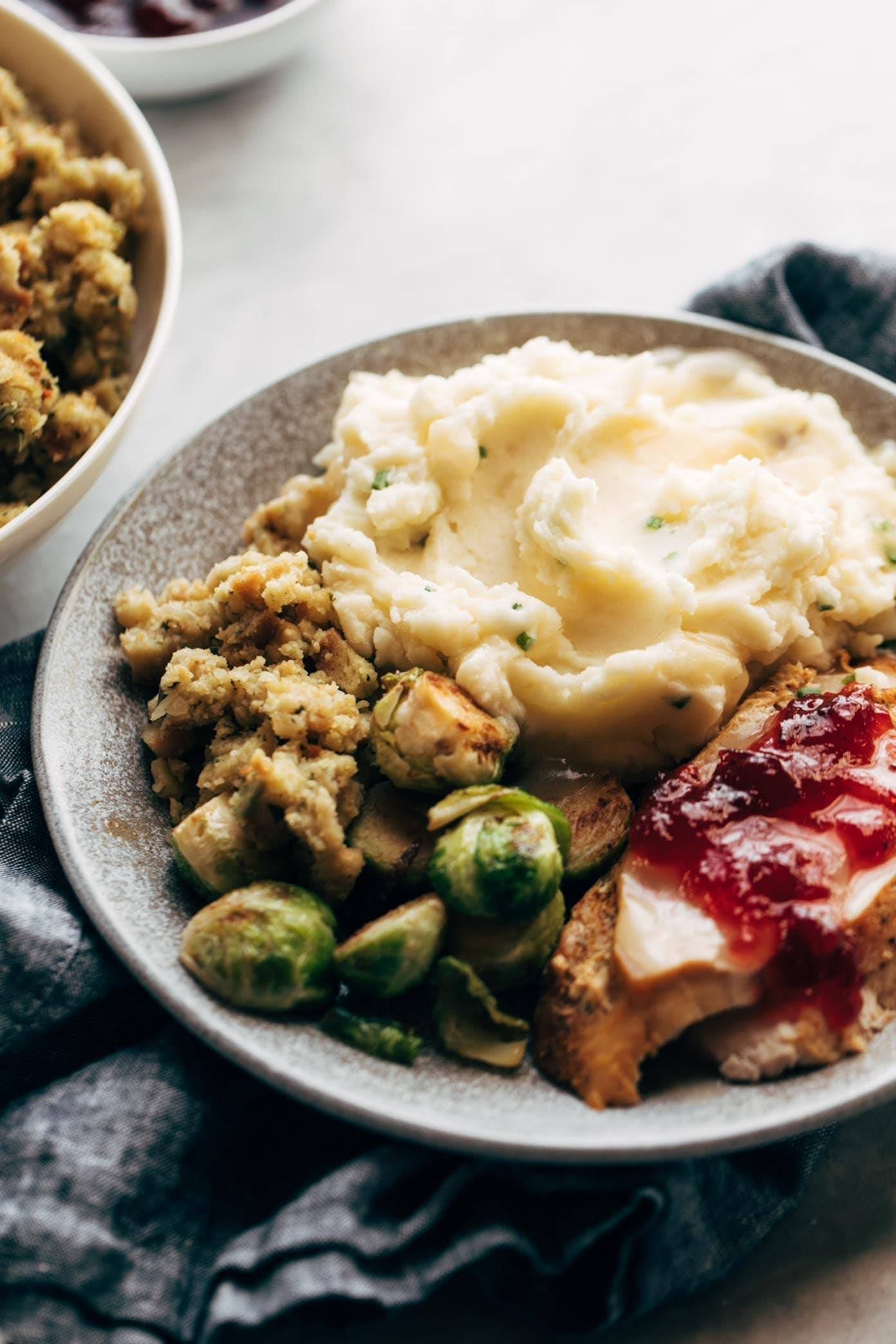 Instant Pot Mashed Potatoes on a plate with stuffing and turkey.
