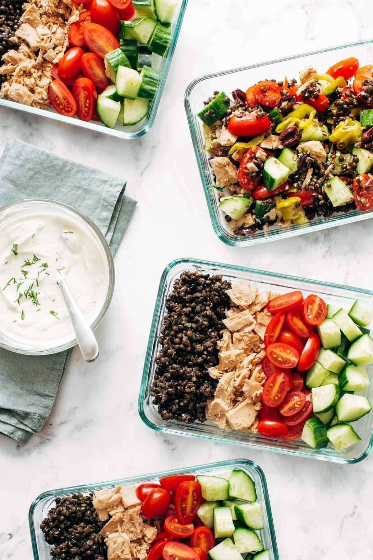 Lentil Greek Salad in meal prep containers.