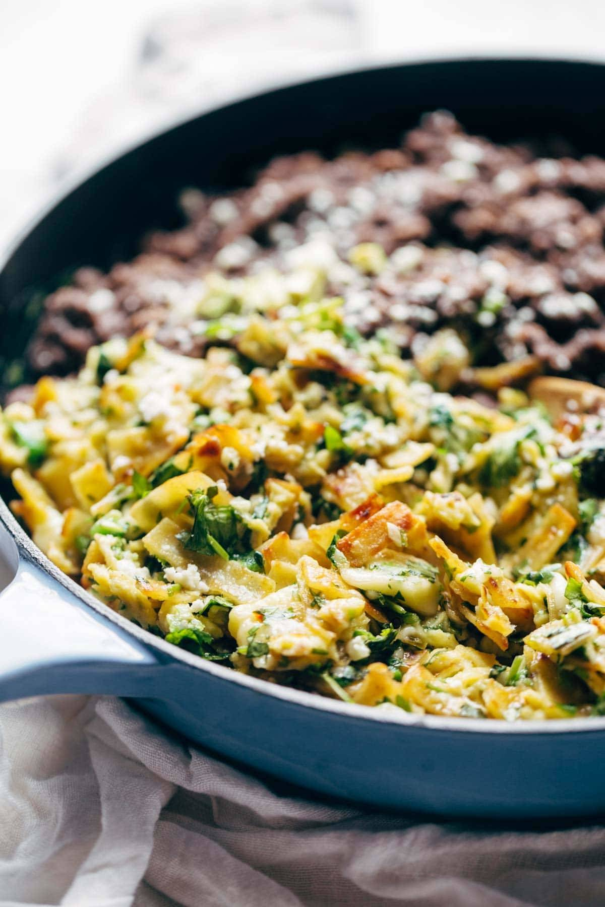 Migas - eggs scrambled with crispy tortillas, garlic, jalapeño, and melted cheese served with black beans and avocado. Quick, easy, and SO DELICIOUS. Breakfast, lunch, dinner, or brunch! | pinchofyum.com