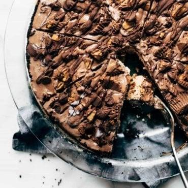 Mocha Peanut Butter Pie in a pie dish with spatula.