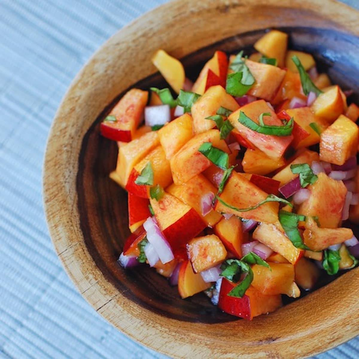 This nectarine basil salsa is made with fresh basil for a delicious, easy, and healthy addition to any meal. Super quick, super easy! | pinchofyum.com