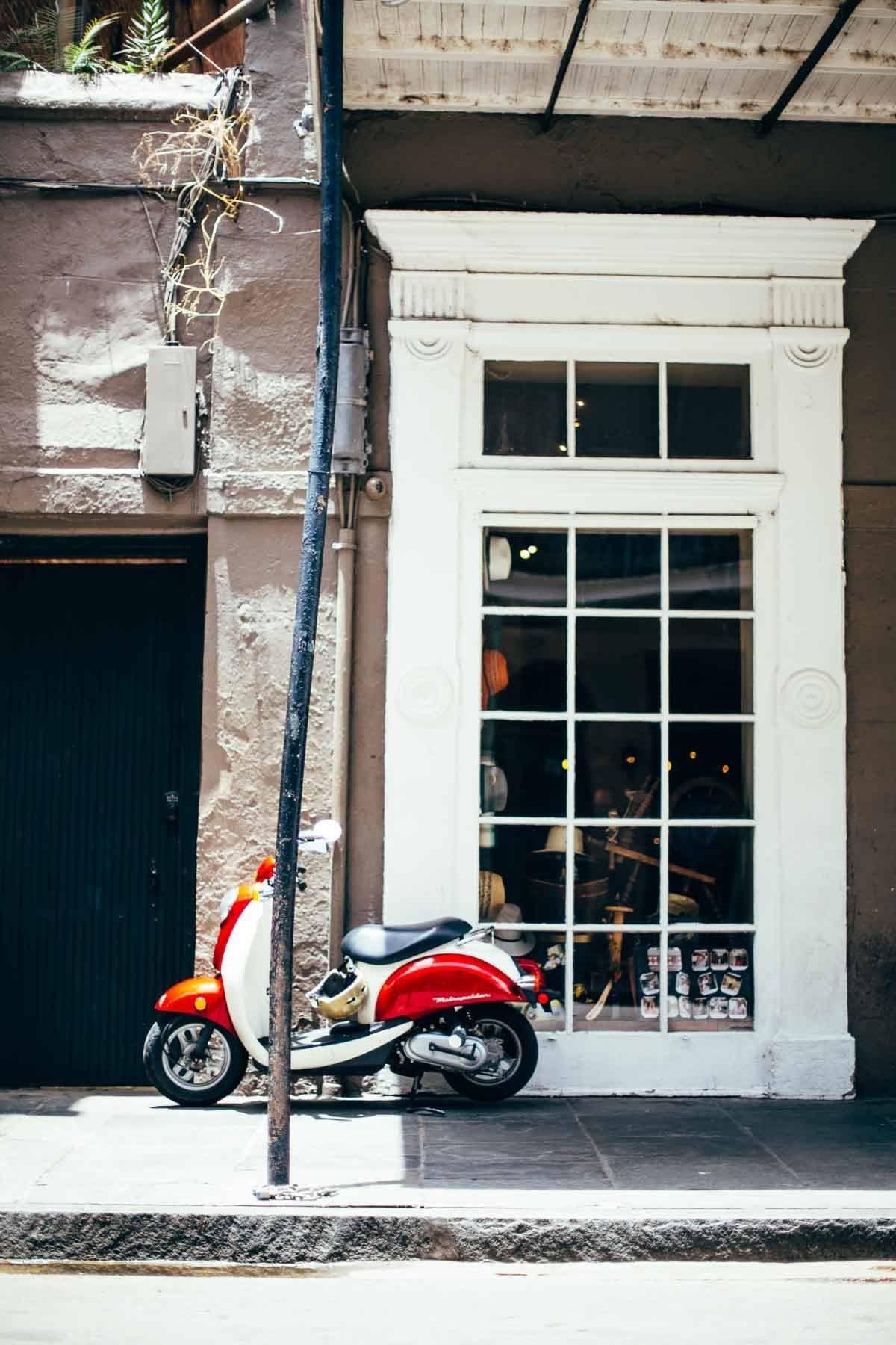 Motor bike on the sidewalk.