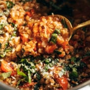 Stewed farro and veggies in a large pot.