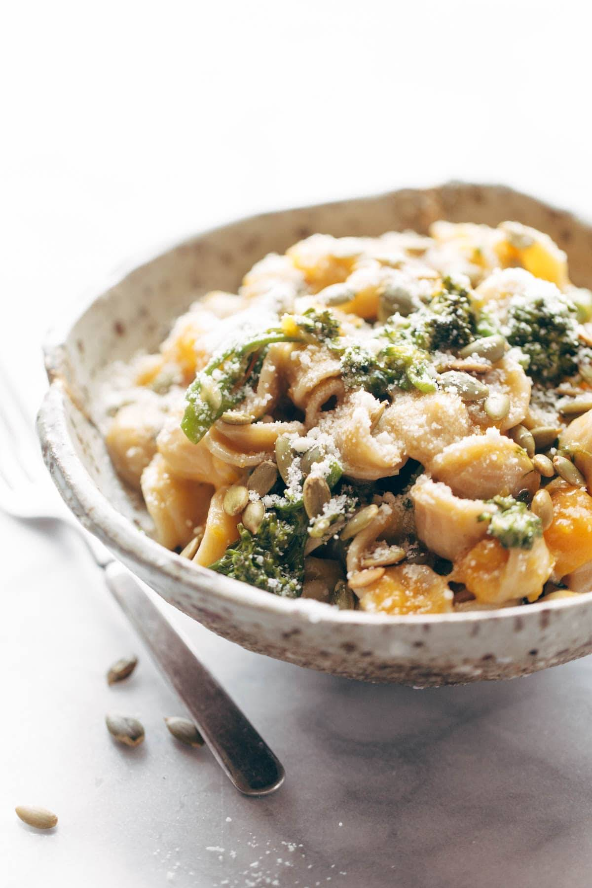 Creamy Parmesan Orecchiette! with roasted butternut squash and broccolini, tossed with a light Parmesan cream / thyme / garlic sauce and sprinkled with pumpkin seeds. Pasta perfection! | pinchofyum.com