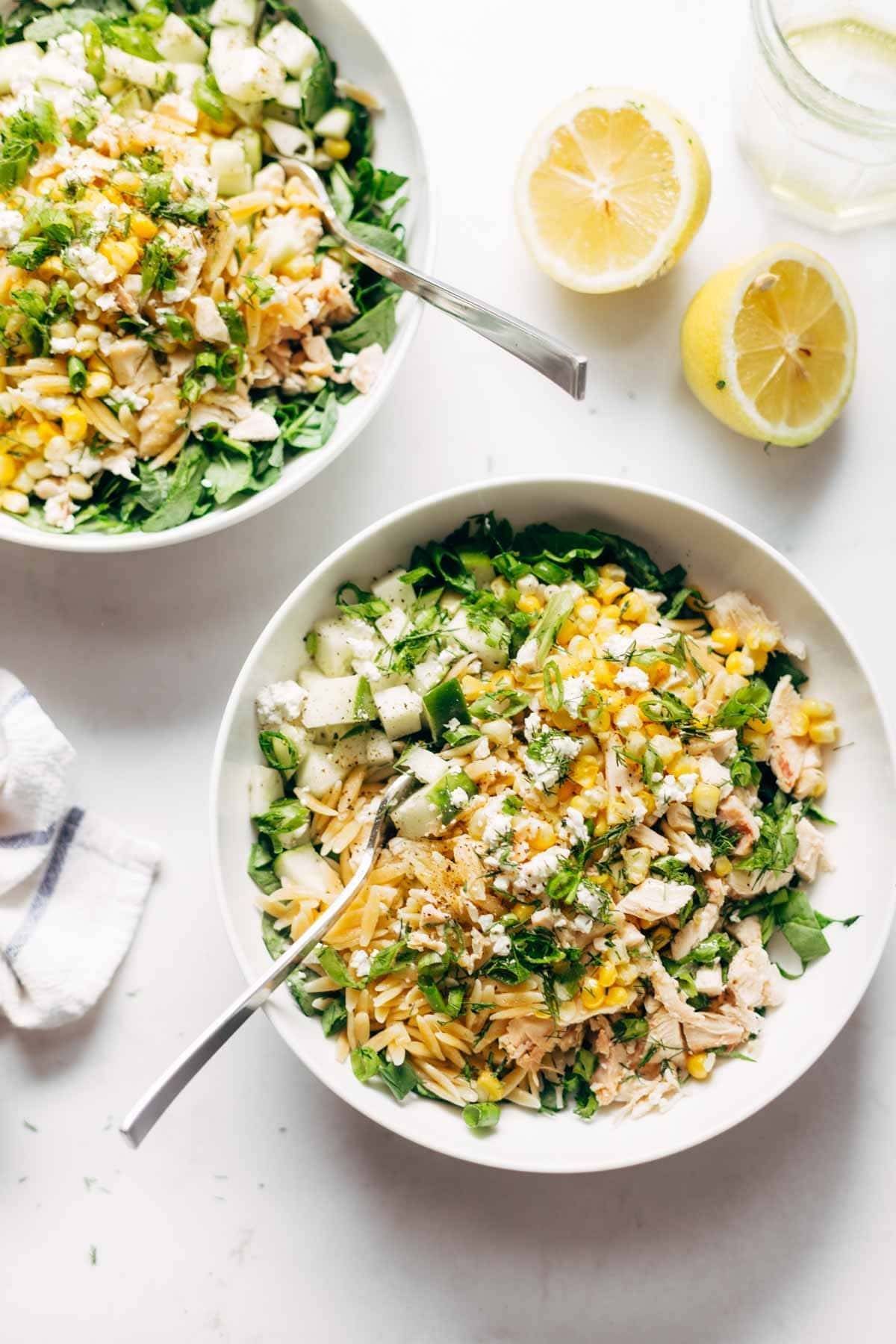 Two bowls of Orzo Summer Salad with forks