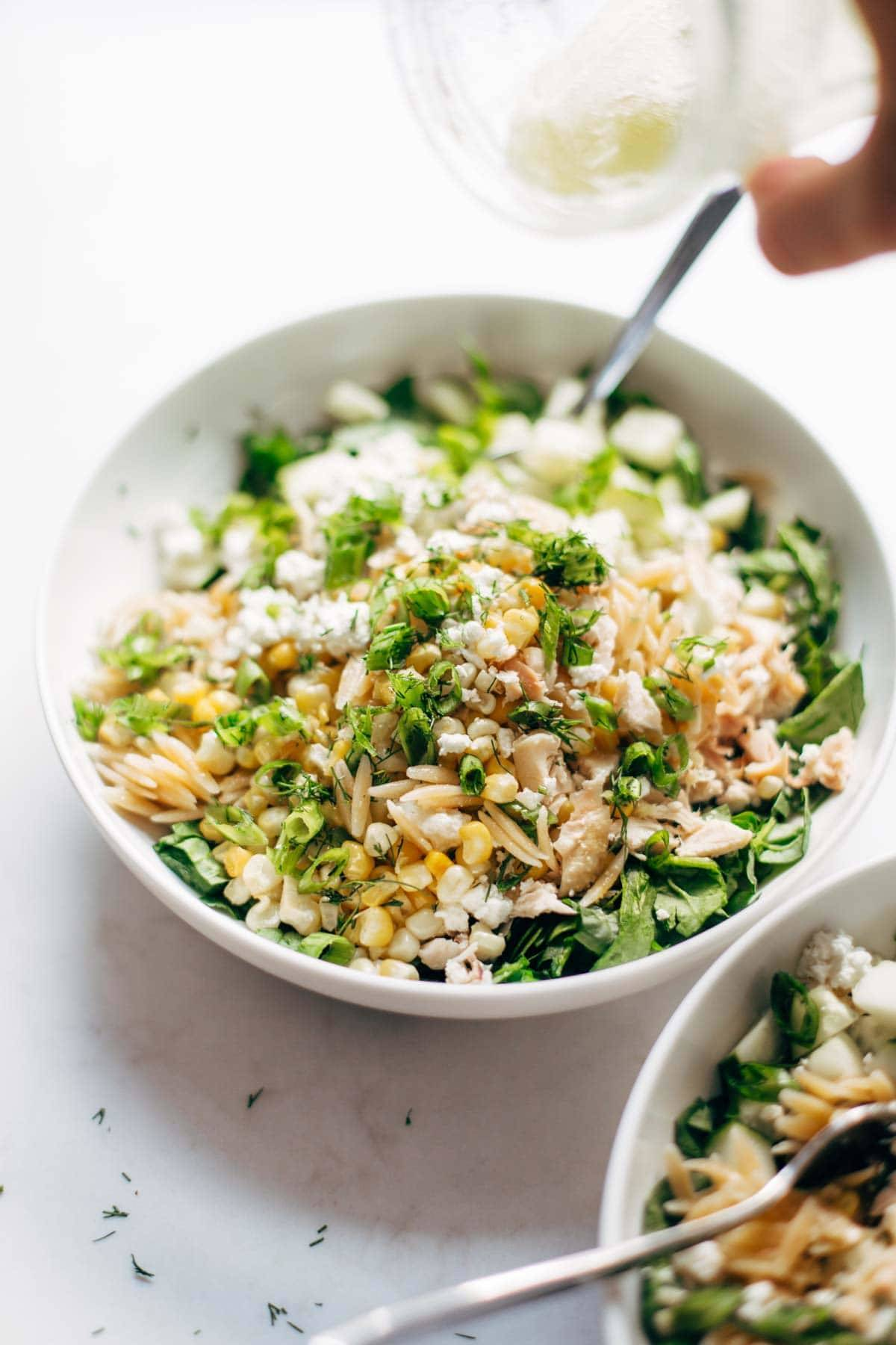 Orzo Summer Salad in a bowl with a fork.