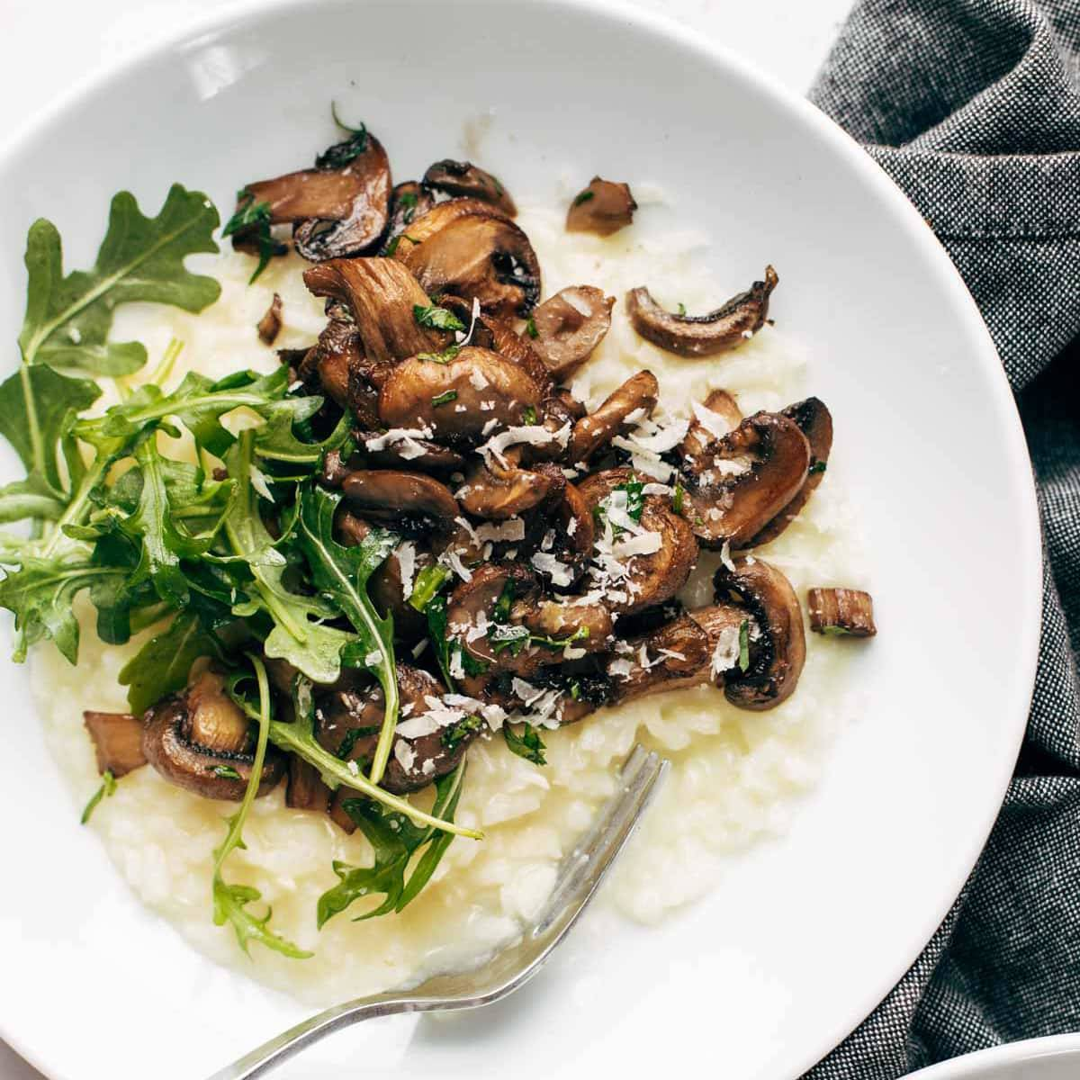 Oven risotto in a bowl with mushrooms.