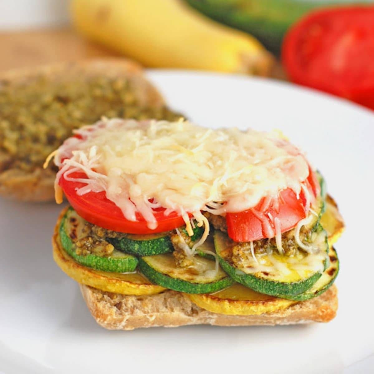 Parmesan and pesto make this grilled veggie sandwich full of flavor! Just a few ingredients and simple preparation to make this vegetarian meal. | pinchofyum.com