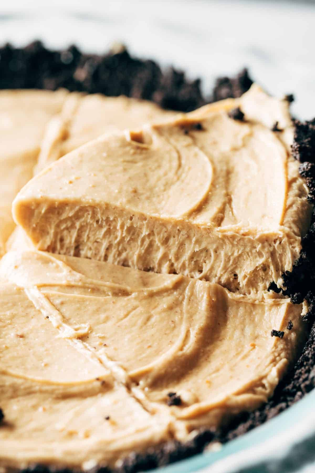 Lifting slice of peanut butter pie.