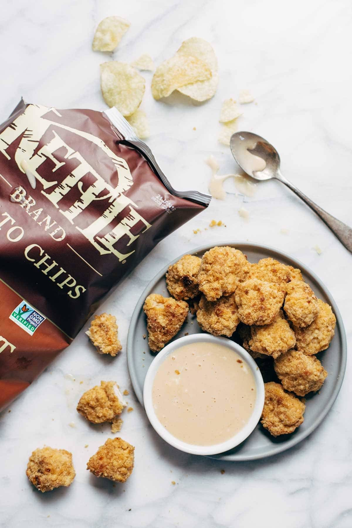 Everyone LOVES these! Baked popcorn chicken that tastes fried! Easy recipe, ready in 30 minutes. SO yummy and fun to share! | pinchofyum.com