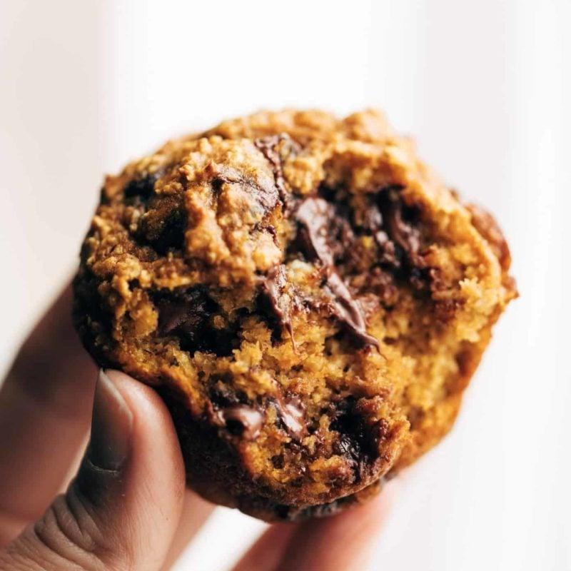 A half-bitten pumpkin muffin.
