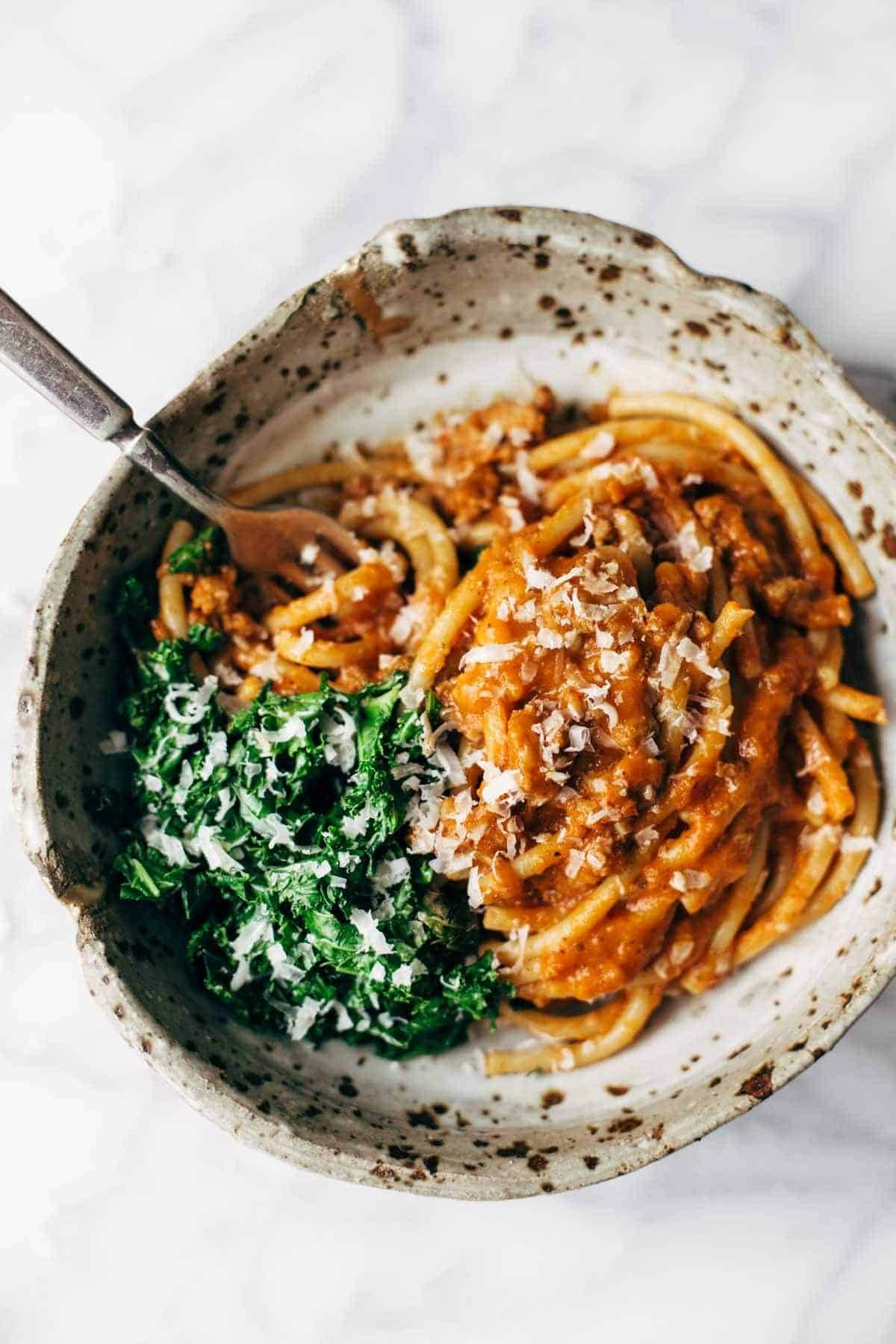 Creamy Pumpkin Spaghetti with Garlic Kale - this is a crazy good combination! Spicy turkey, creamy pumpkin sauce, and pasta - love this recipe! | pinchofyum.com