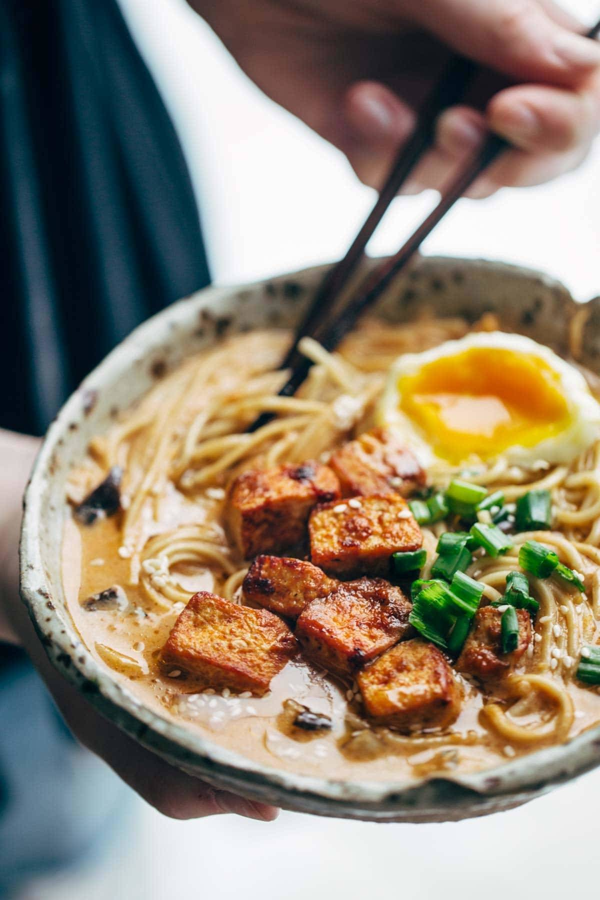 Homemade Spicy Ramen recipe with an easy spicy miso paste for the broth and dry ramen noodles that taste JUST like fresh! Vegetarian / vegan. | pinchofyum.com