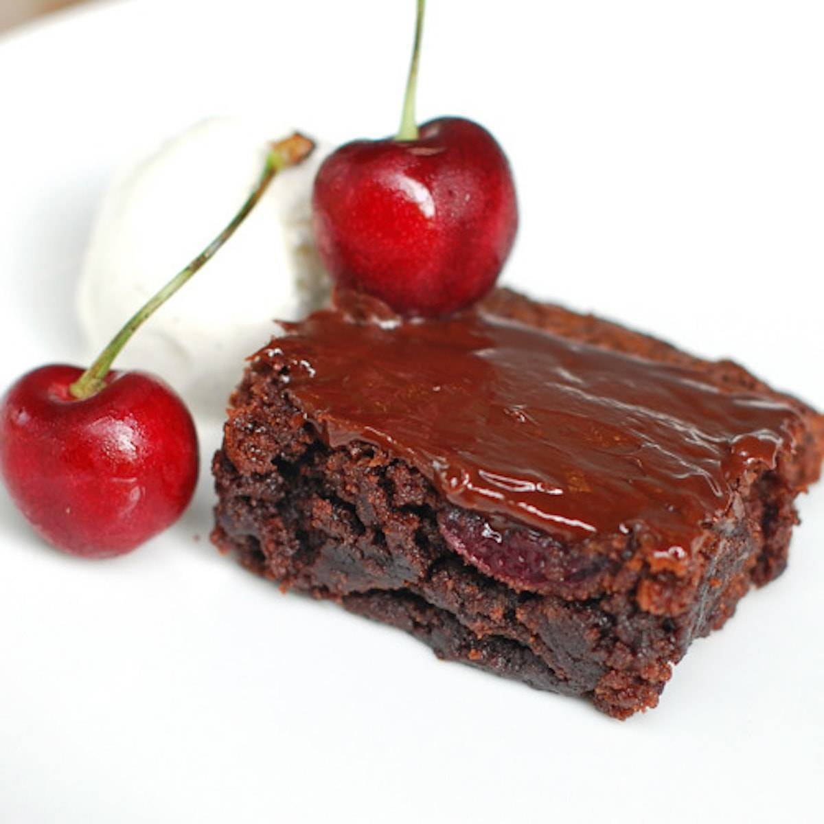 Roasted cherry brownie with ice cream and cherries.