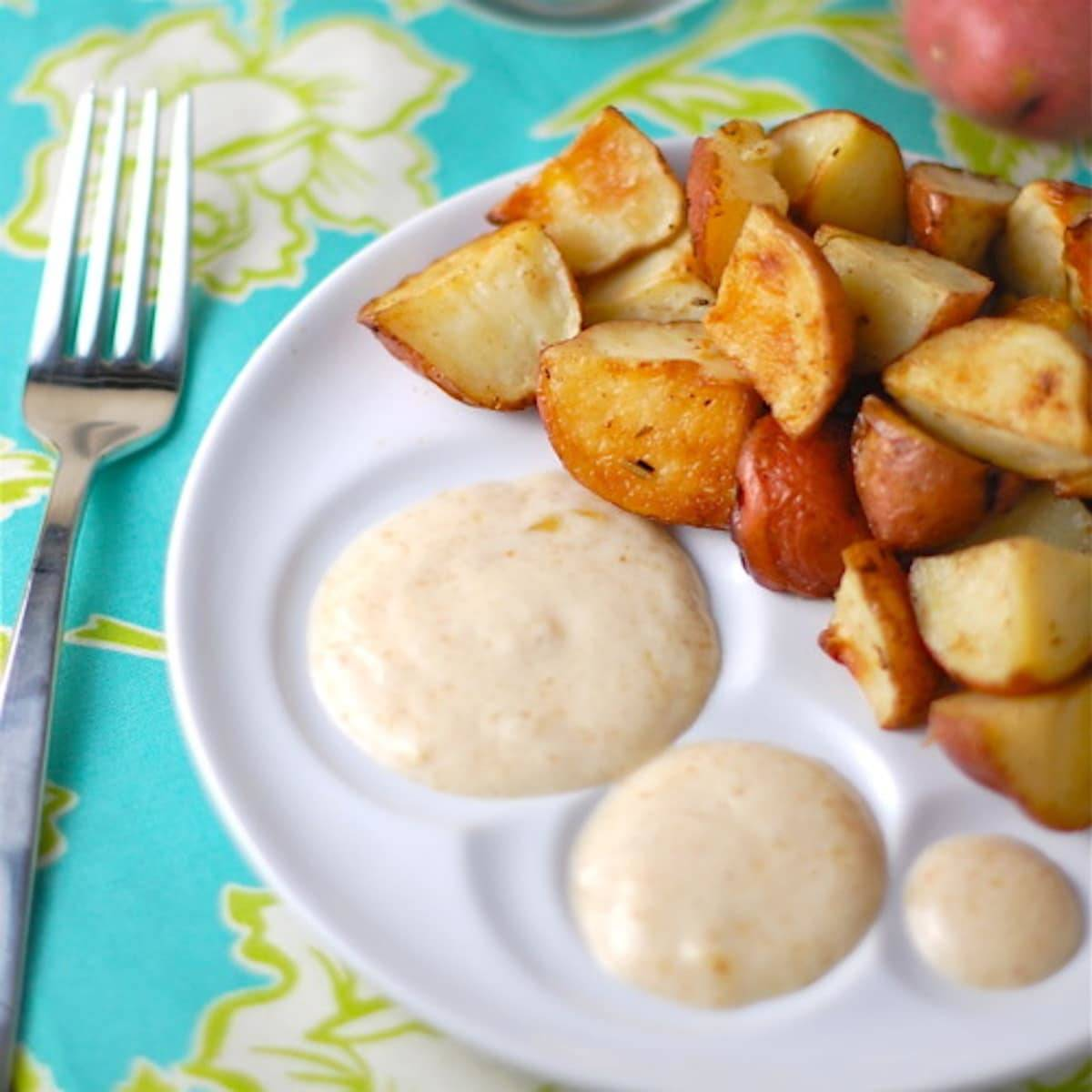 This simple maple fig sauce is made with maple syrup and fig preserves and served with simple roasted potatoes. A unique and delicious meal! | pinchofyum.com