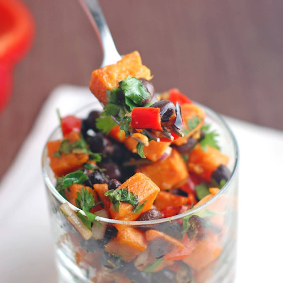 This roasted sweet potato salad features black beans, bell peppers, and of course, roasted sweet potatoes with a simple dressing. Fresh and yummy! | pinchofyum.com