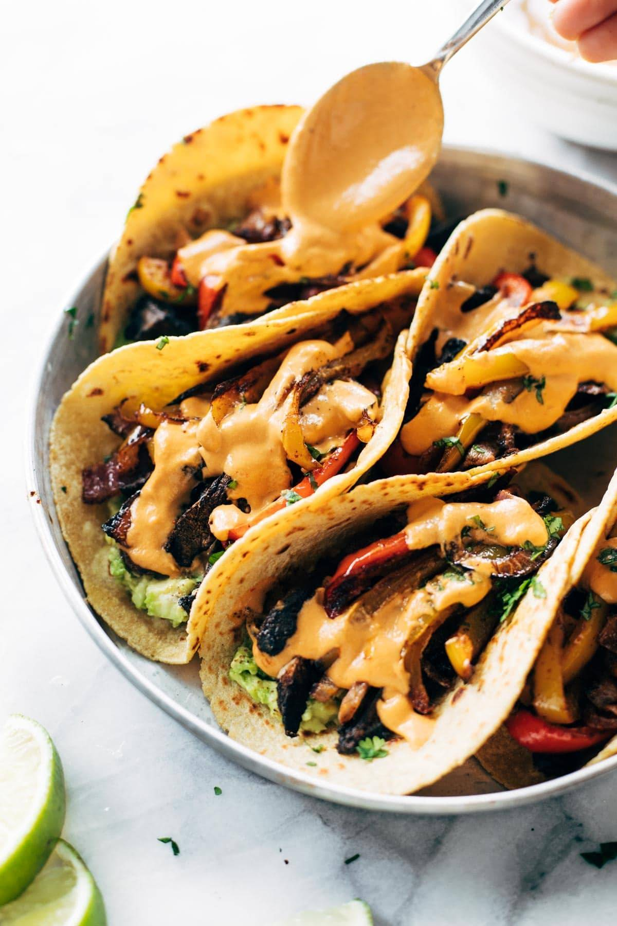 A plate of fajitas and with queso.