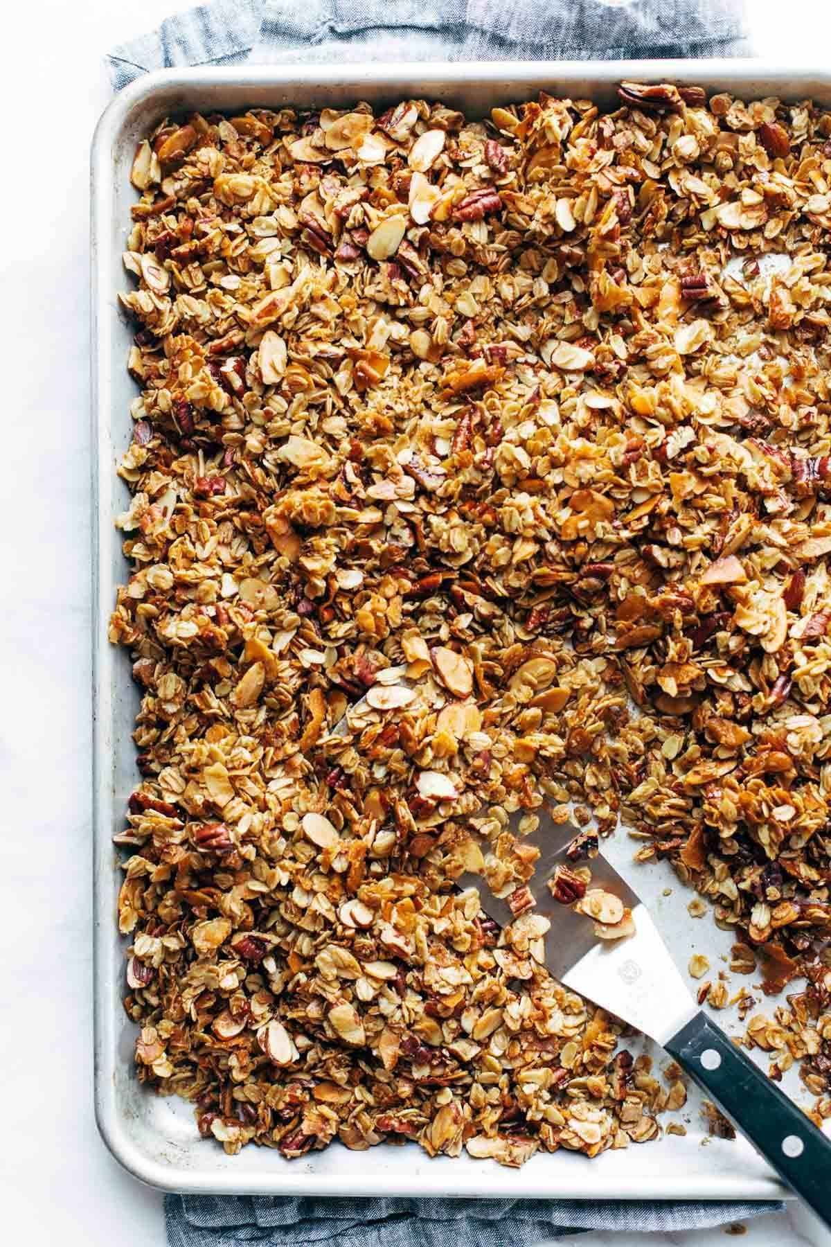 Baked granola on a baking sheet.