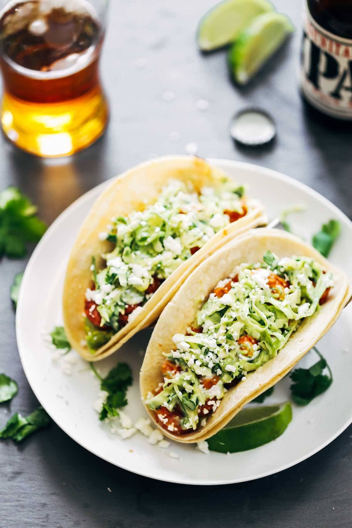Spicy Shrimp Tacos with Garlic Cilantro Lime Slaw - ready in about 30 minutes and loaded with flavor and texture. SO YUM! | pinchofyum.com