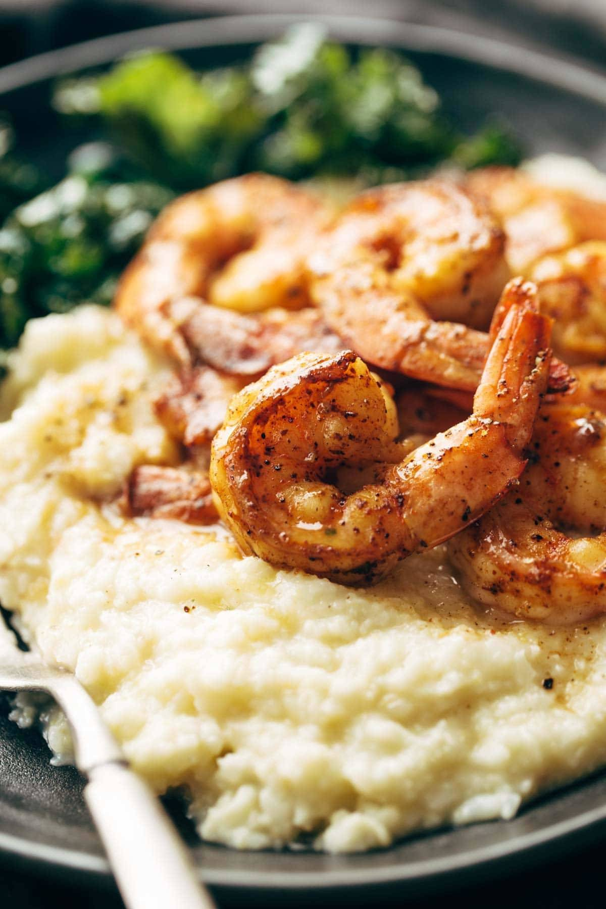 shrimp and cauliflower mash on a plate with a fork
