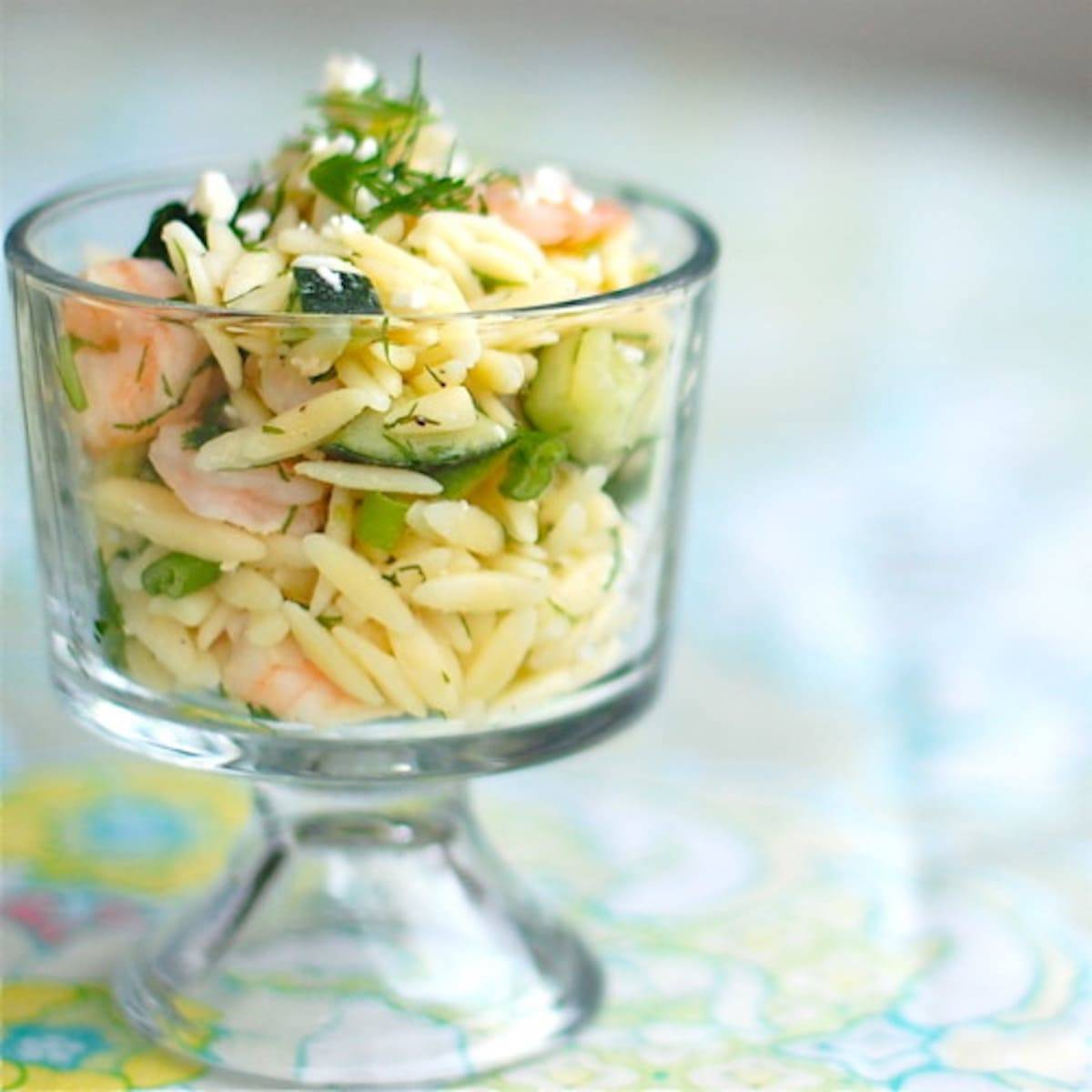 Shrimp and feta orzo in a glass dish.