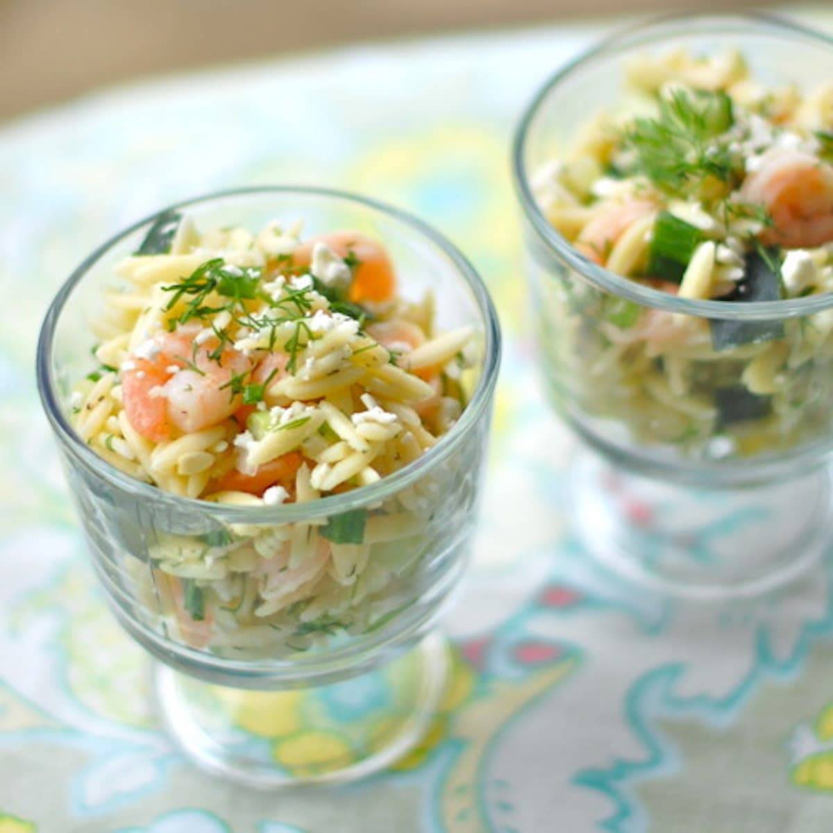 Shrimp and feta orzo in two dishes.