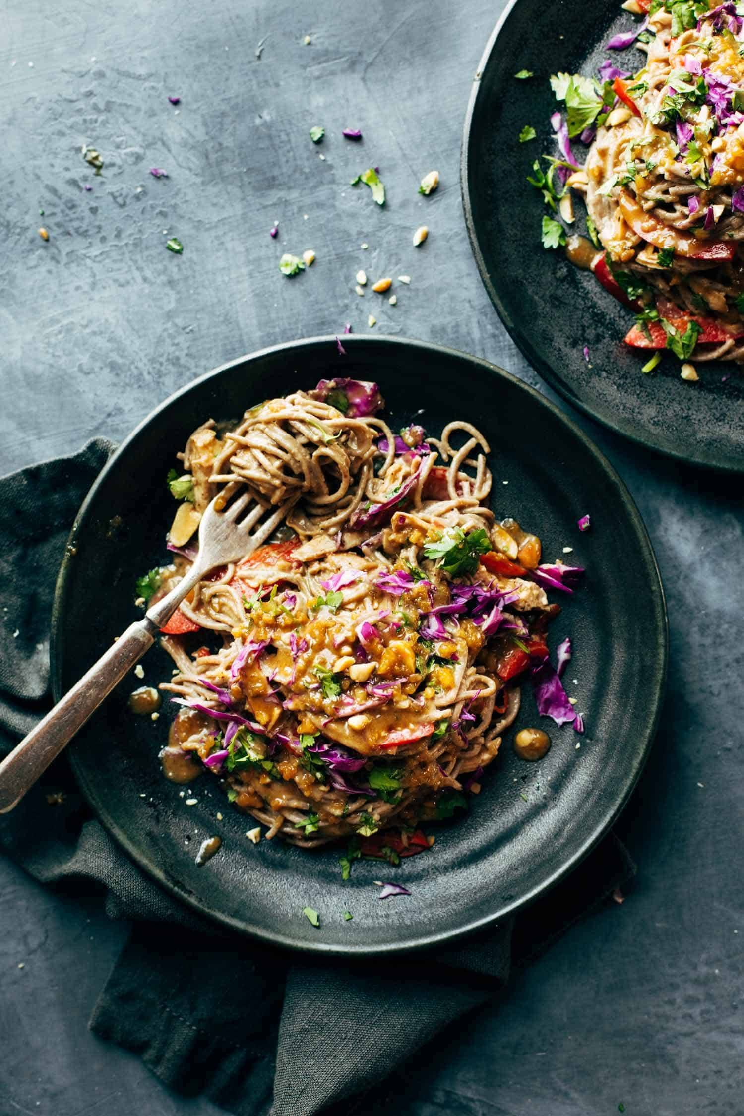 Spicy Peanut Soba Noodle Salad - red peppers, cabbage, chicken, soba noodles, and a quick homemade spicy peanut sauce. salads don't get much yummier than this. gluten free. | pinchofyum.com