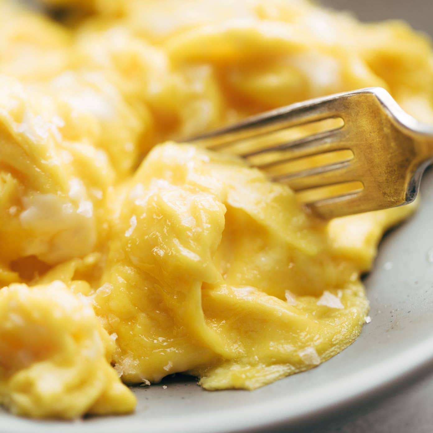 Soft Scrambled Eggs on plate with fork.
