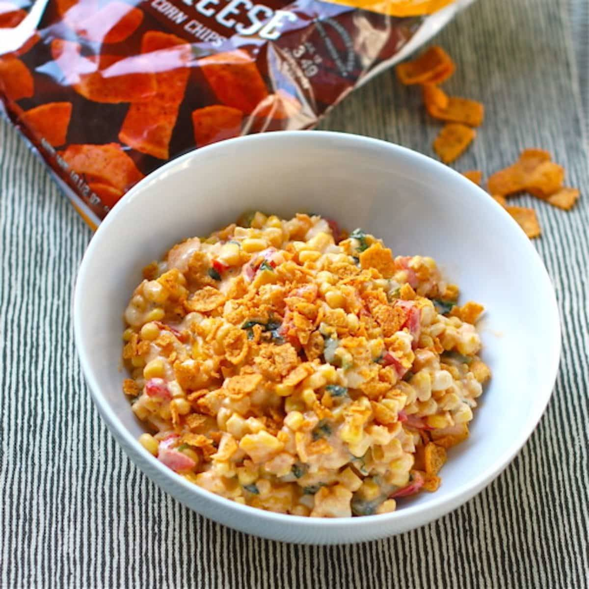 Spicy corn salad with fritos in a bowl.