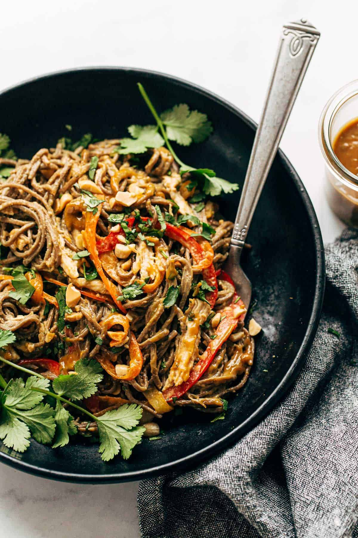 Spicy Peanut Soba Noodle Salad in a bowl with a fork.