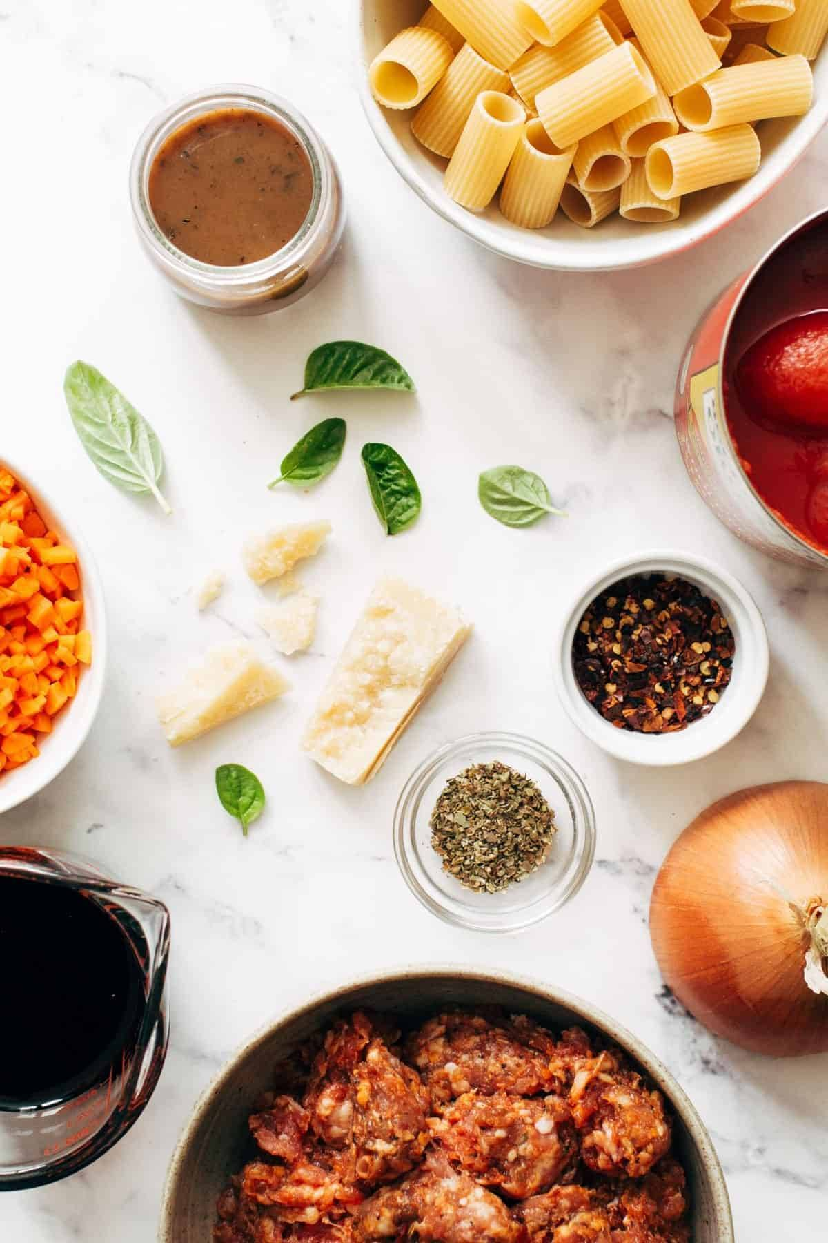 Ingredients in bowls for Spicy Sausage Rigatoni.