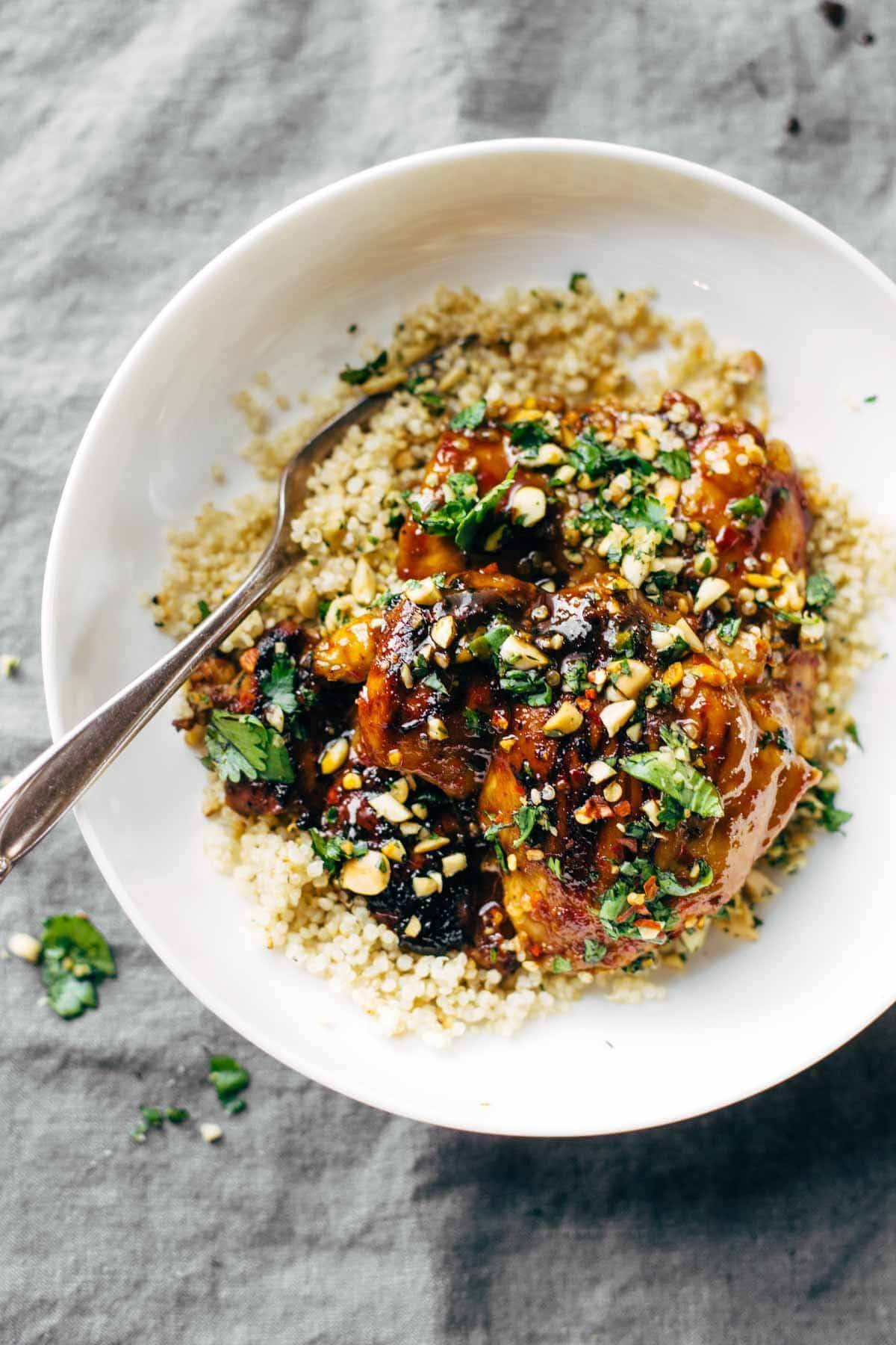 chicken with quinoa and cilantro in a bowl with a fork