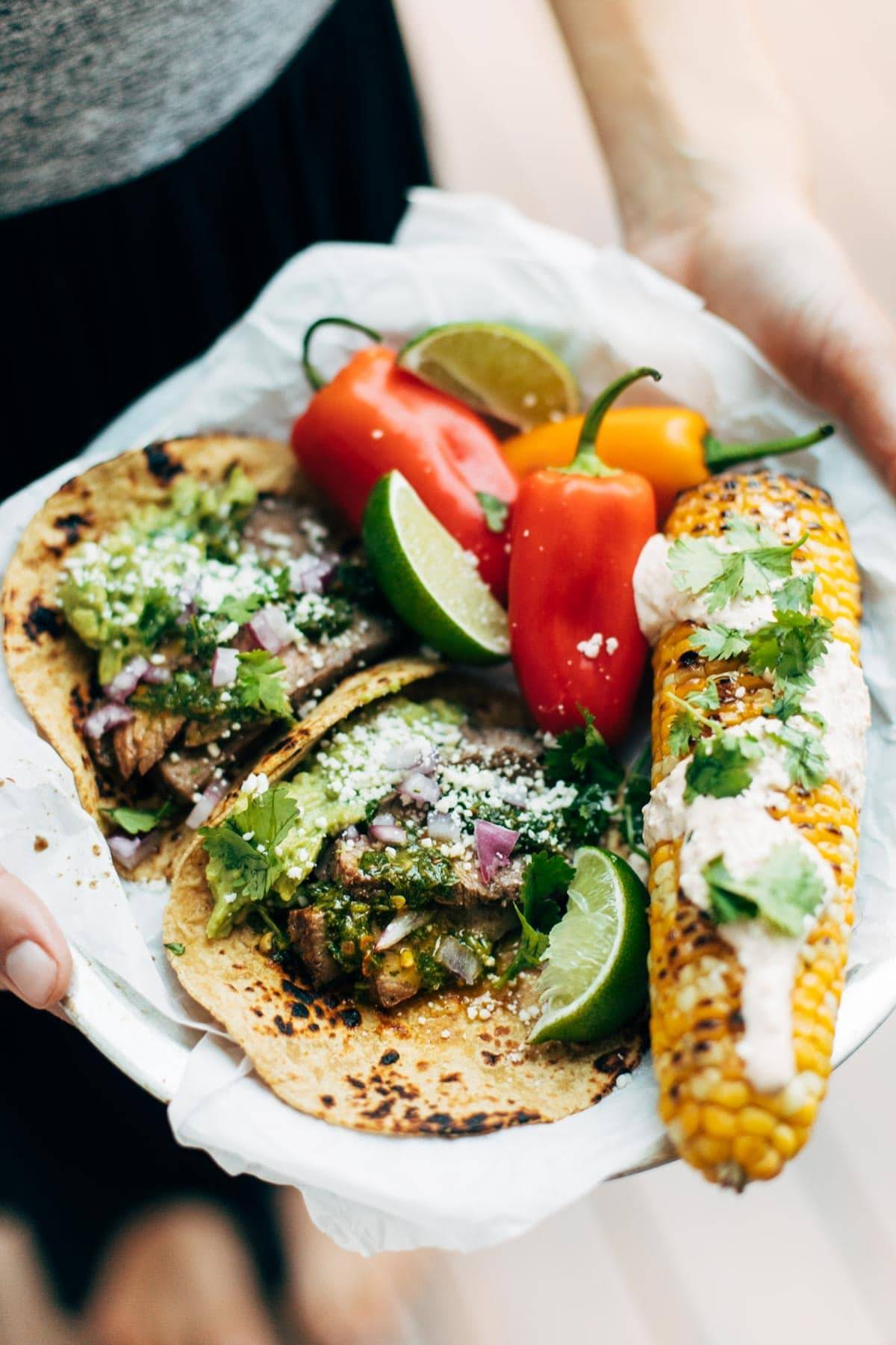 Chimichurri Steak Tacos with corn and peppers.