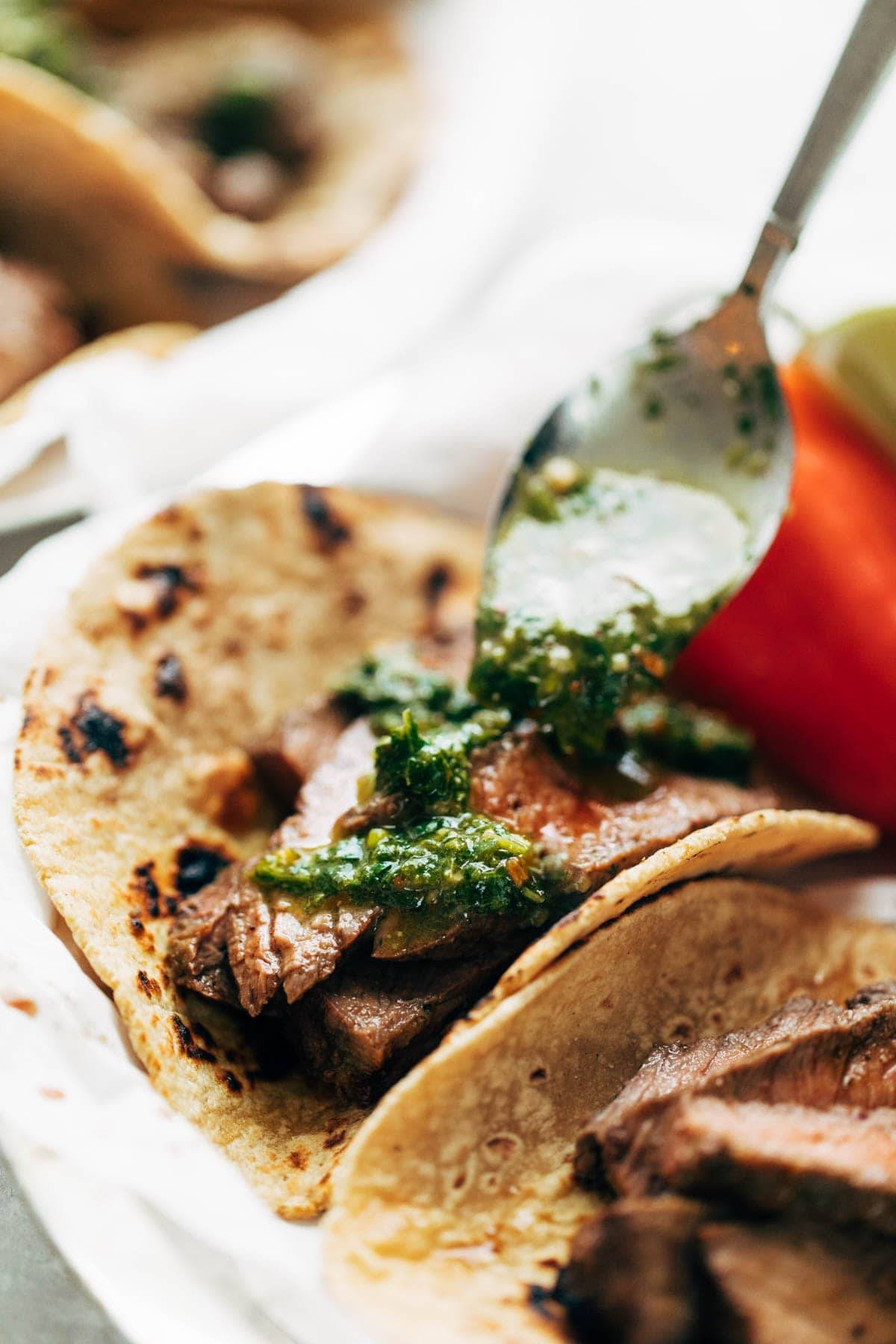Chimichurri Steak Tacos drizzled with chimi sauce.