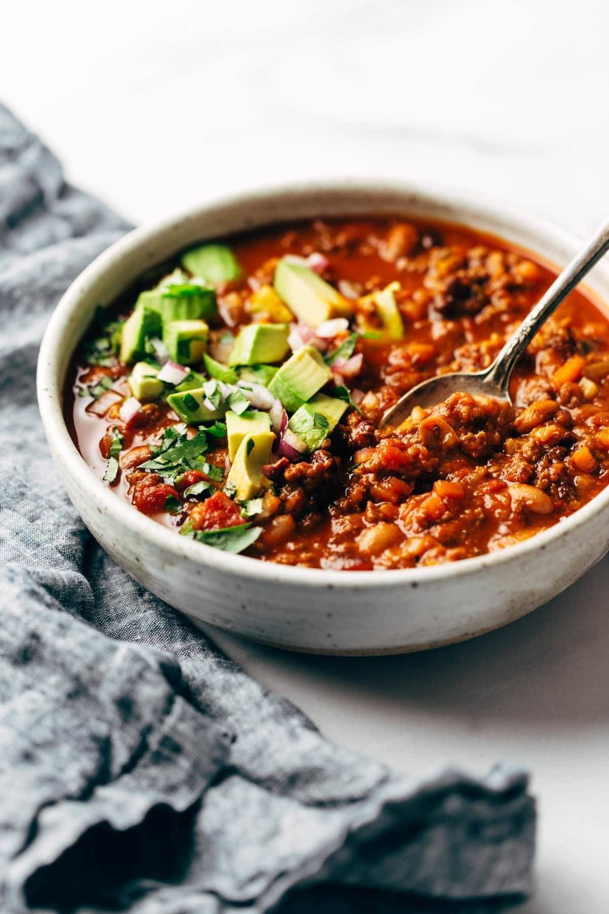Sunday chili in a bowl with a spoon.