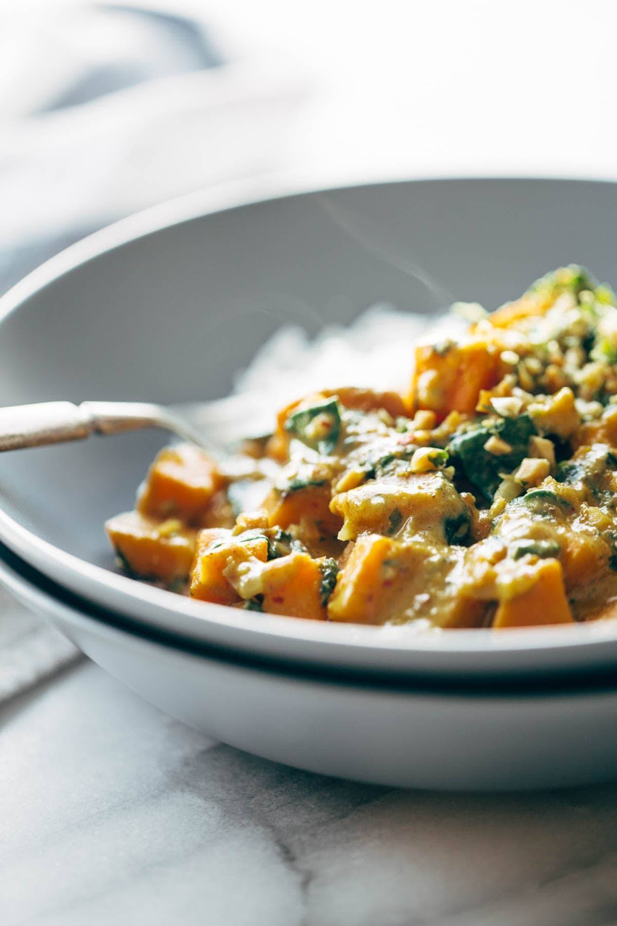 Creamy Thai Sweet Potato Curry in two bowls.