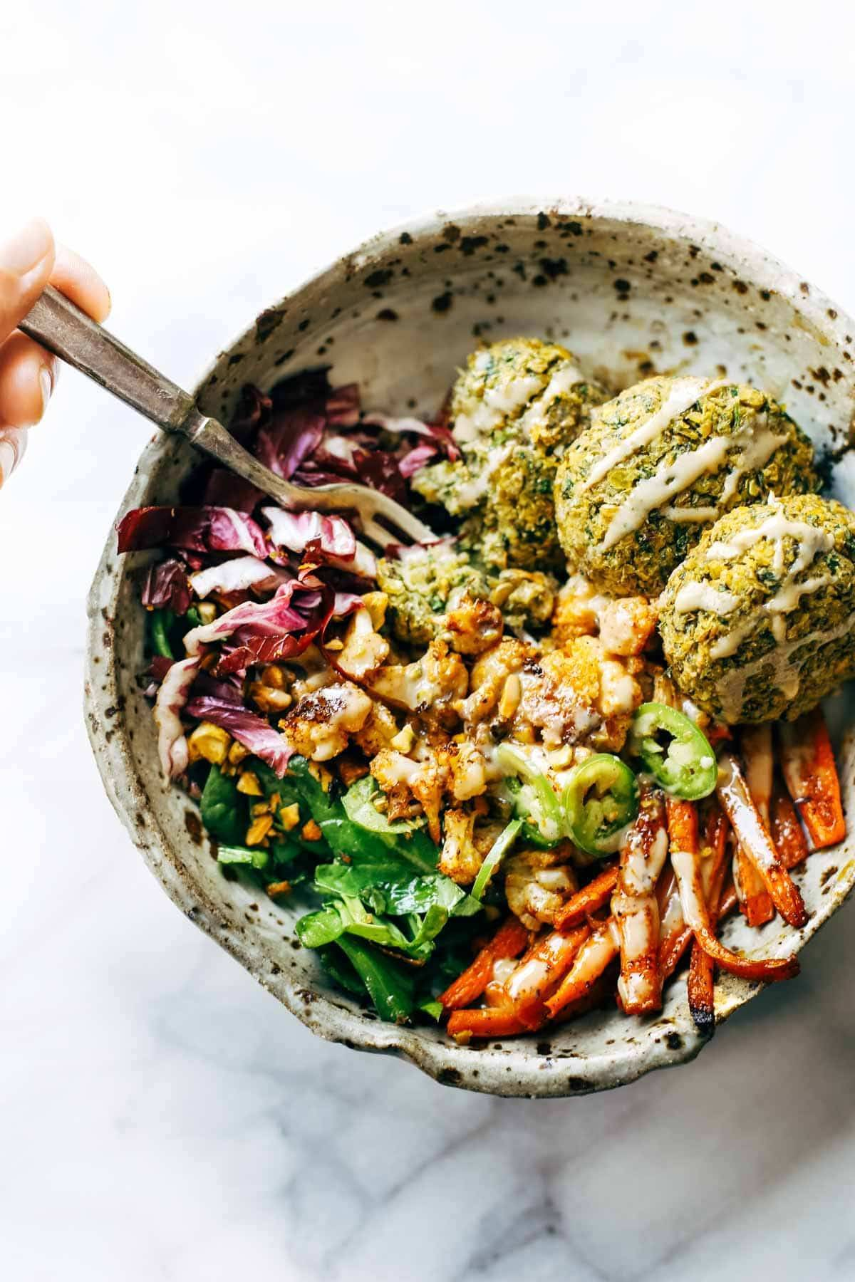 Keep your glow all winter! Easy homemade falafel, roasted veggies, and flavorful sauce all in one big bliss bowl! vegetarian / vegan / gluten free recipe. | pinchofyum.com