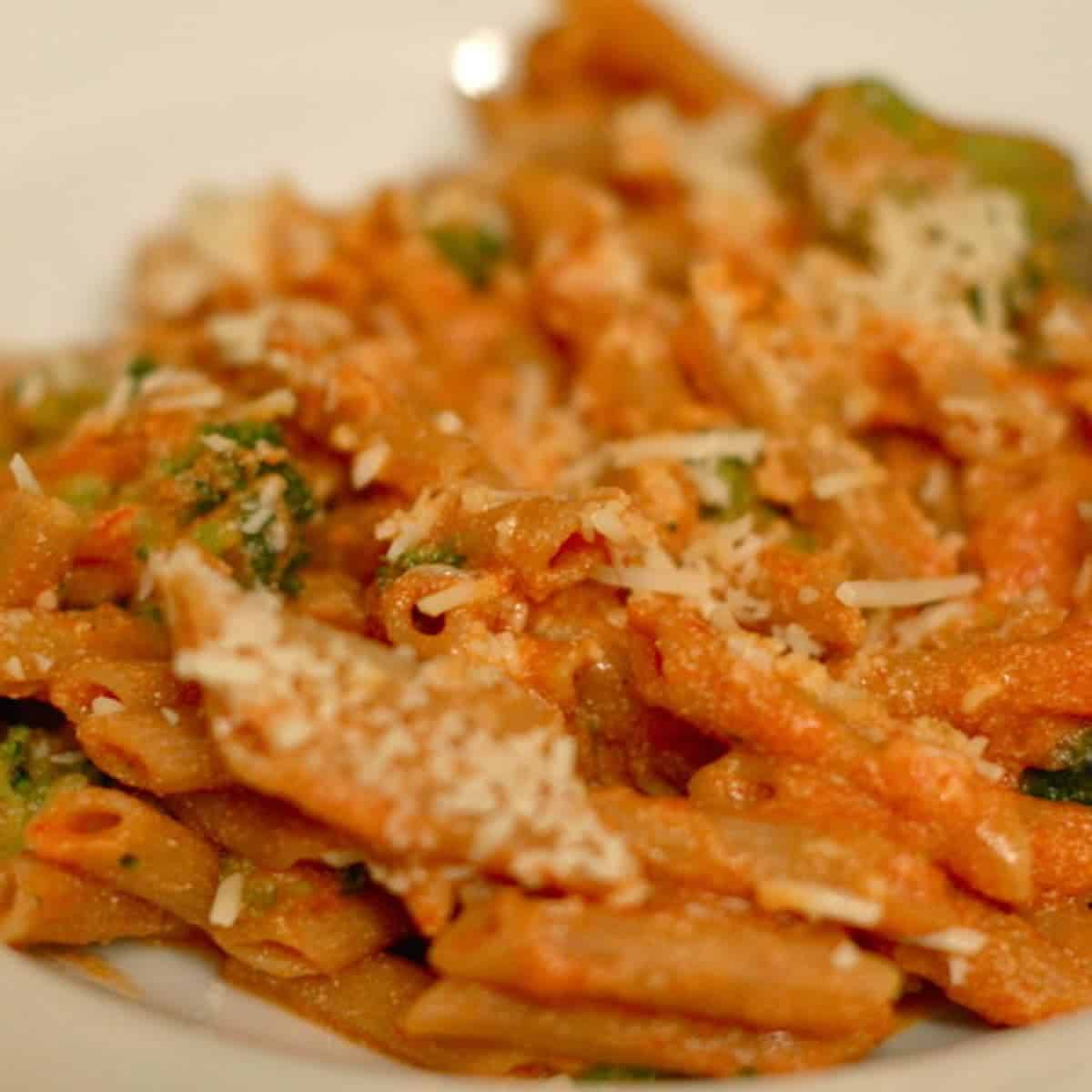 Tomato Ricotta Pasta with Broccoli and cheese shreds.