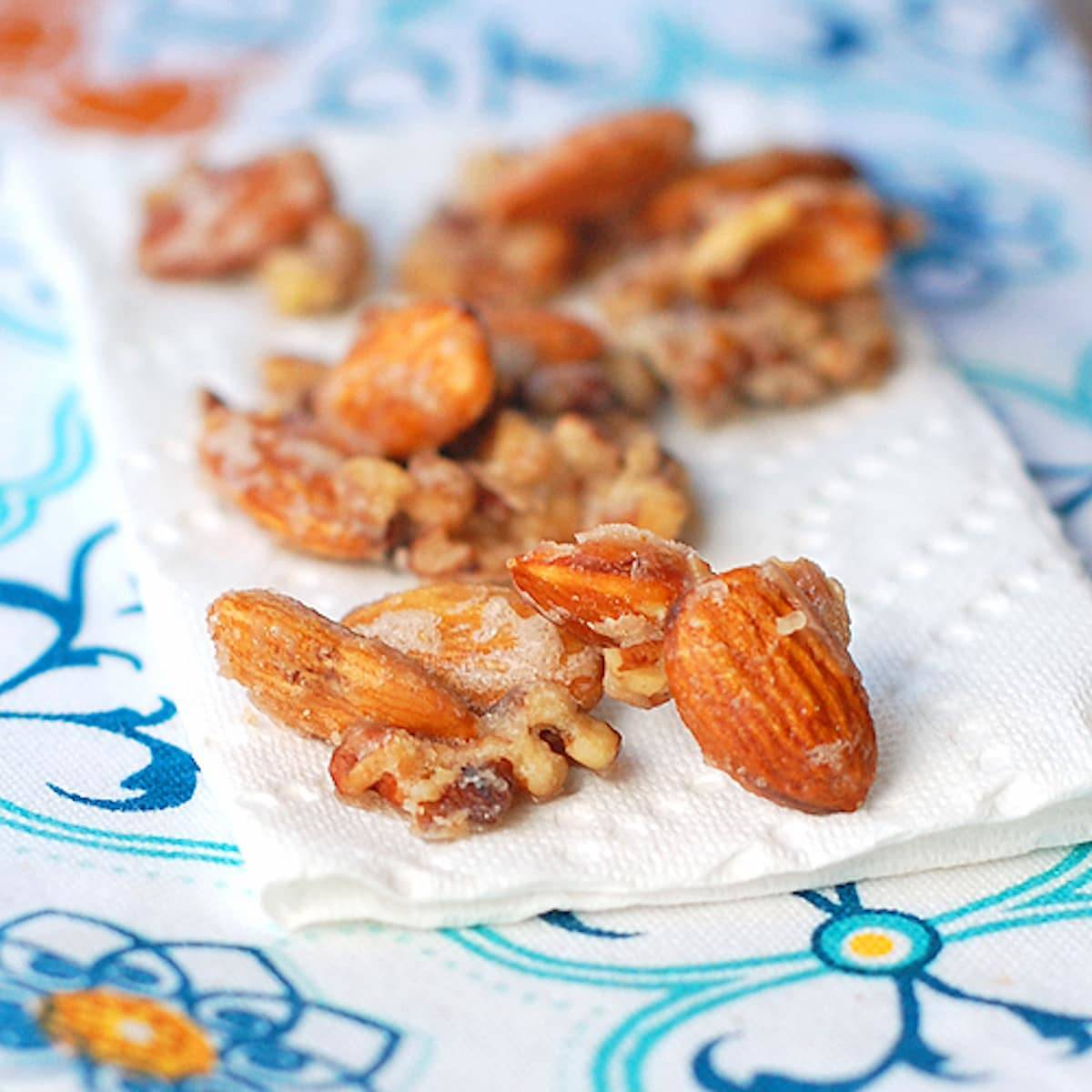 These maple vanilla almond clusters are made from scratch and so addicting! Sweet, sugary, crunchy, and a little salty. Perfect snack! | pinchofyum.com