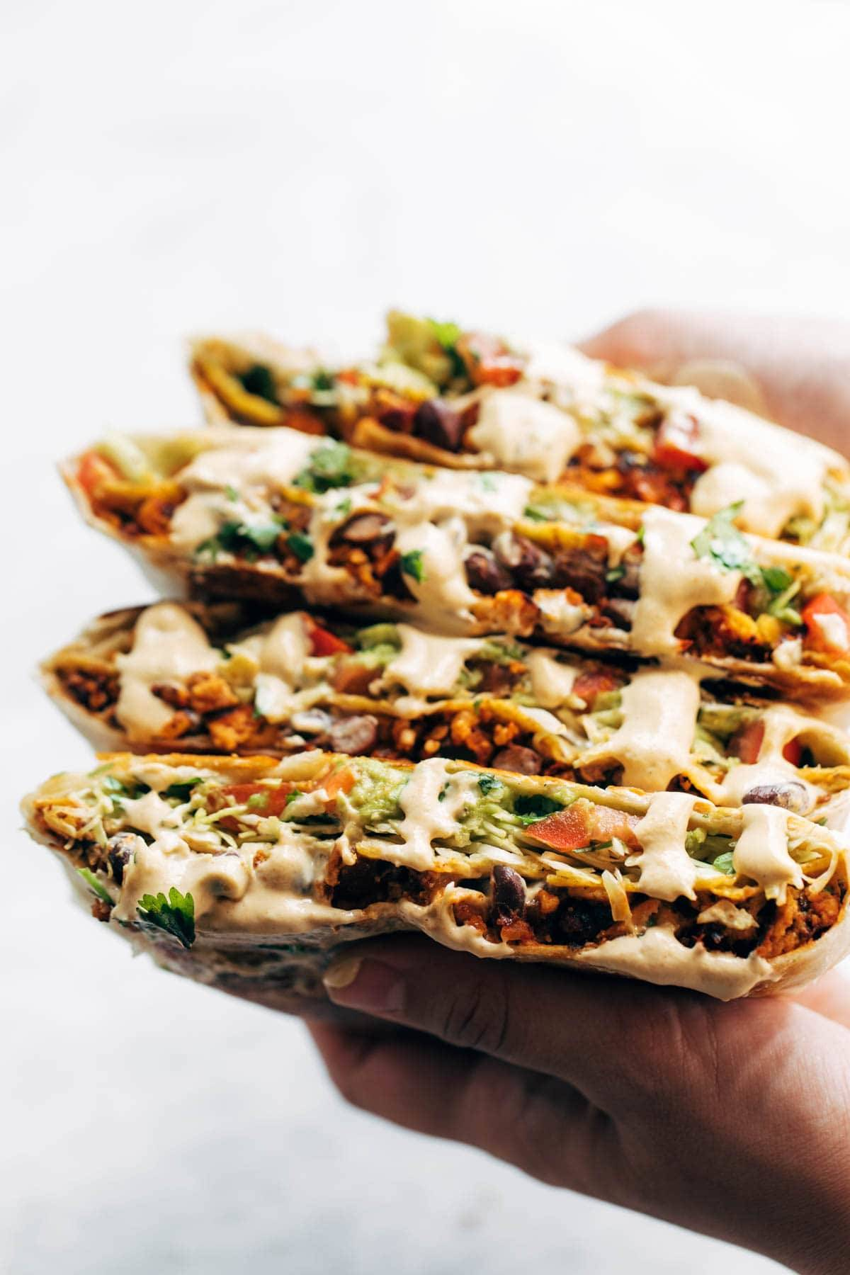 Cashew queso on vegan crunchwrap supreme.