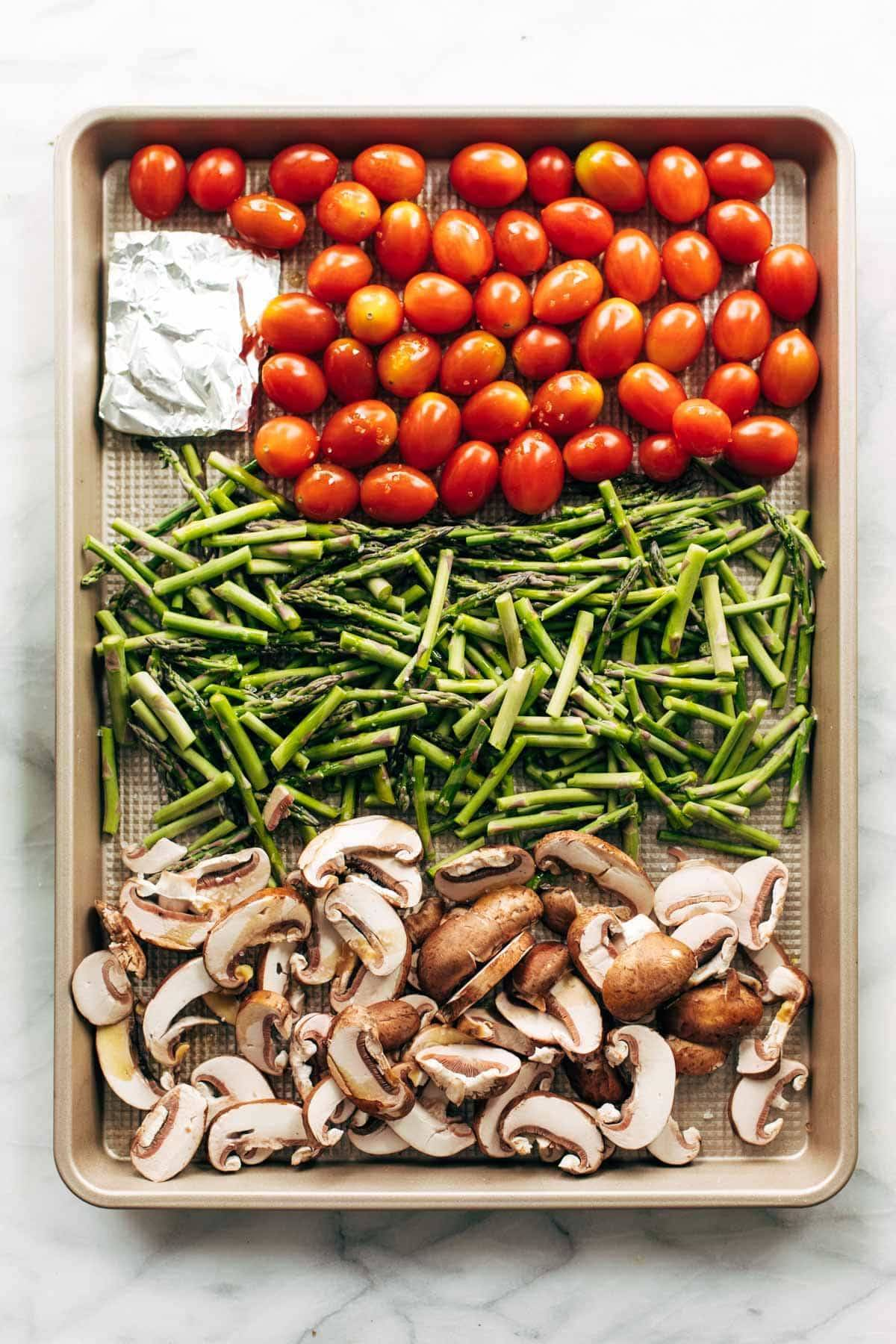 Vegetables on a sheet pan for roasting.