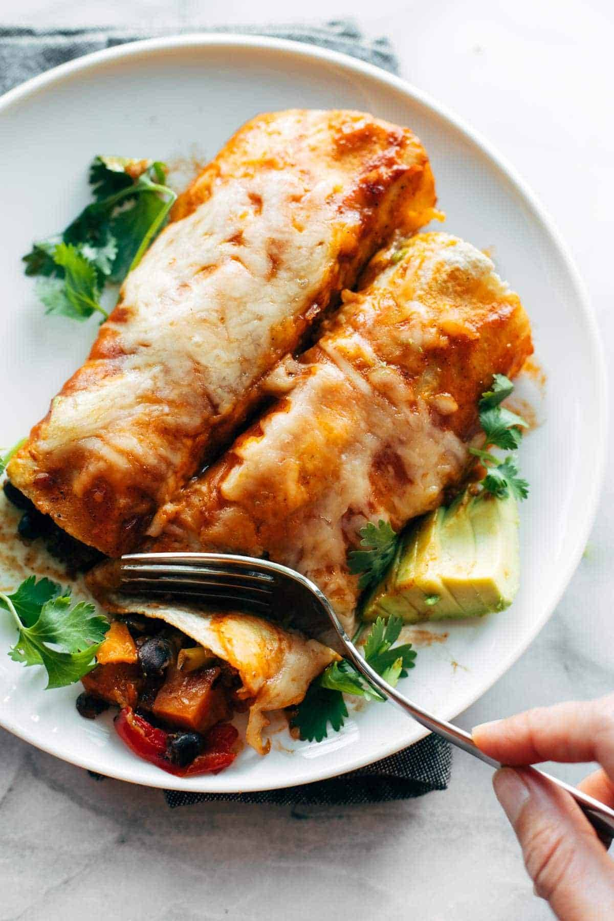 Taking bite out of veggie enchiladas.