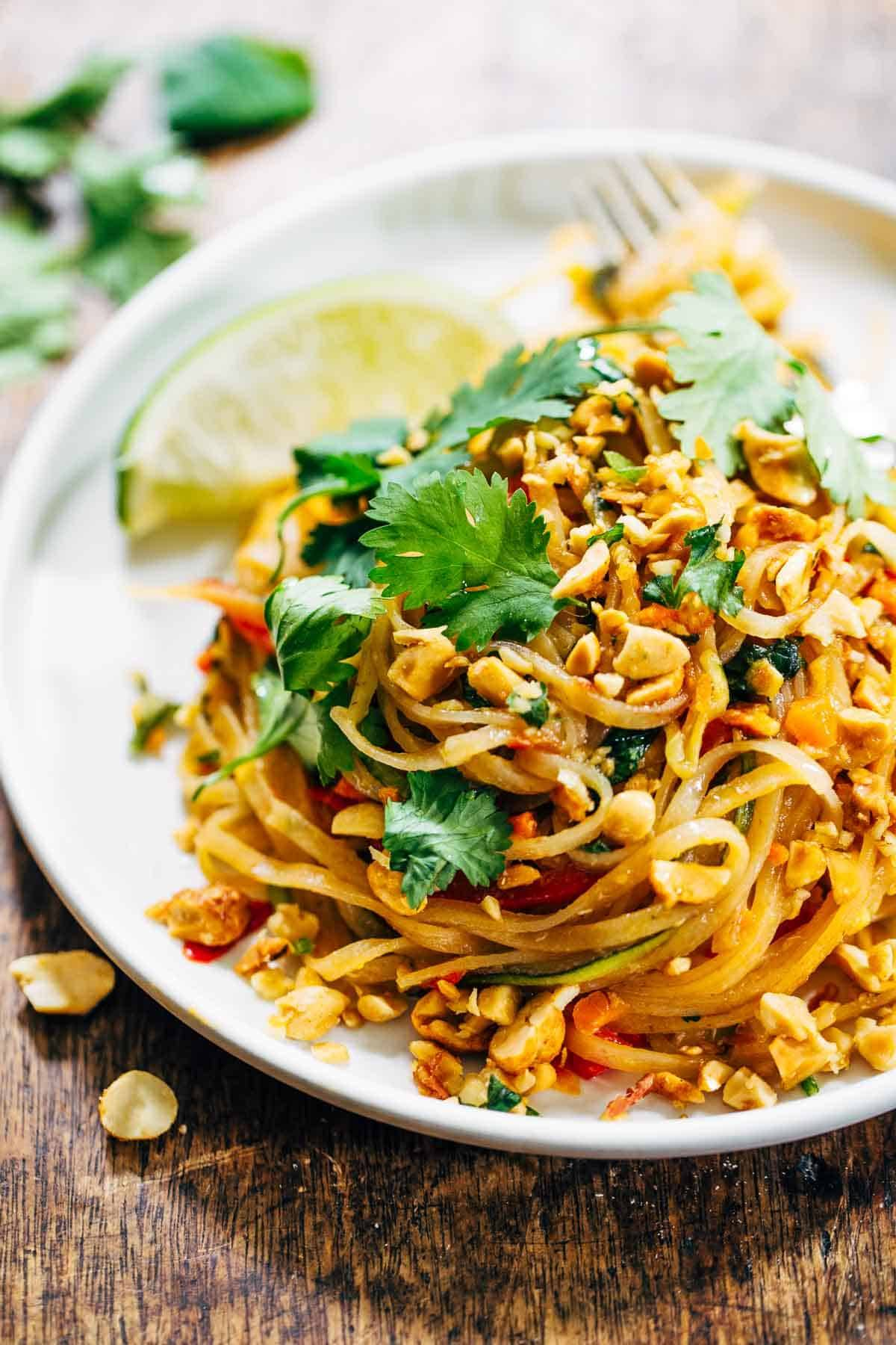 Rainbow vegetarian pad thai with peanuts and basil recipe pinch of yum vegetarian pad thai on plate click here to pin this recipe forumfinder Choice Image