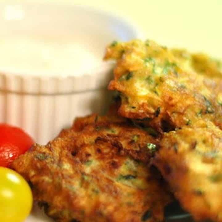 Zucchini Fritters with Goat Cheese Sauce   pinchofyum.com