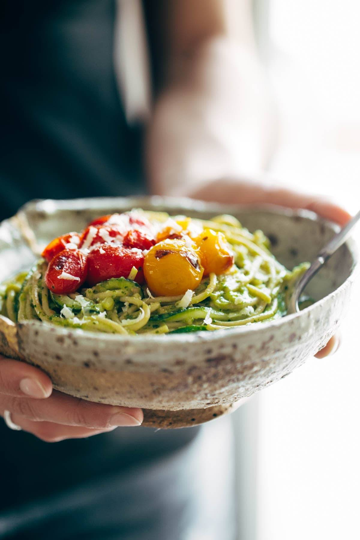 Burst Tomato and Zucchini Spaghetti in a bowl with a fork.