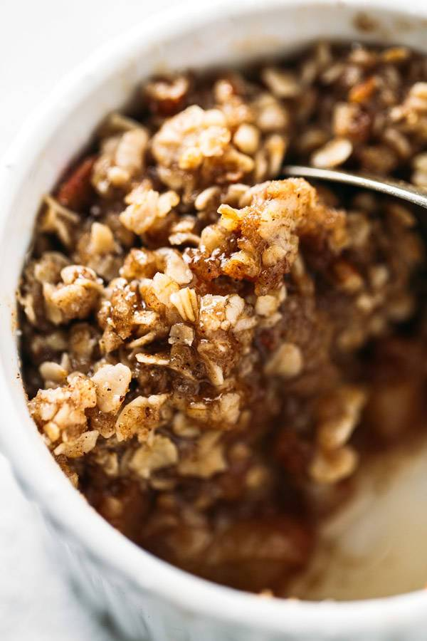 Five Minute Single Serving Apple Crisp with a wholesome oat, pecan, and coconut oil topping. Made super fast in the microwave! No oven required. | pinchofyum.com