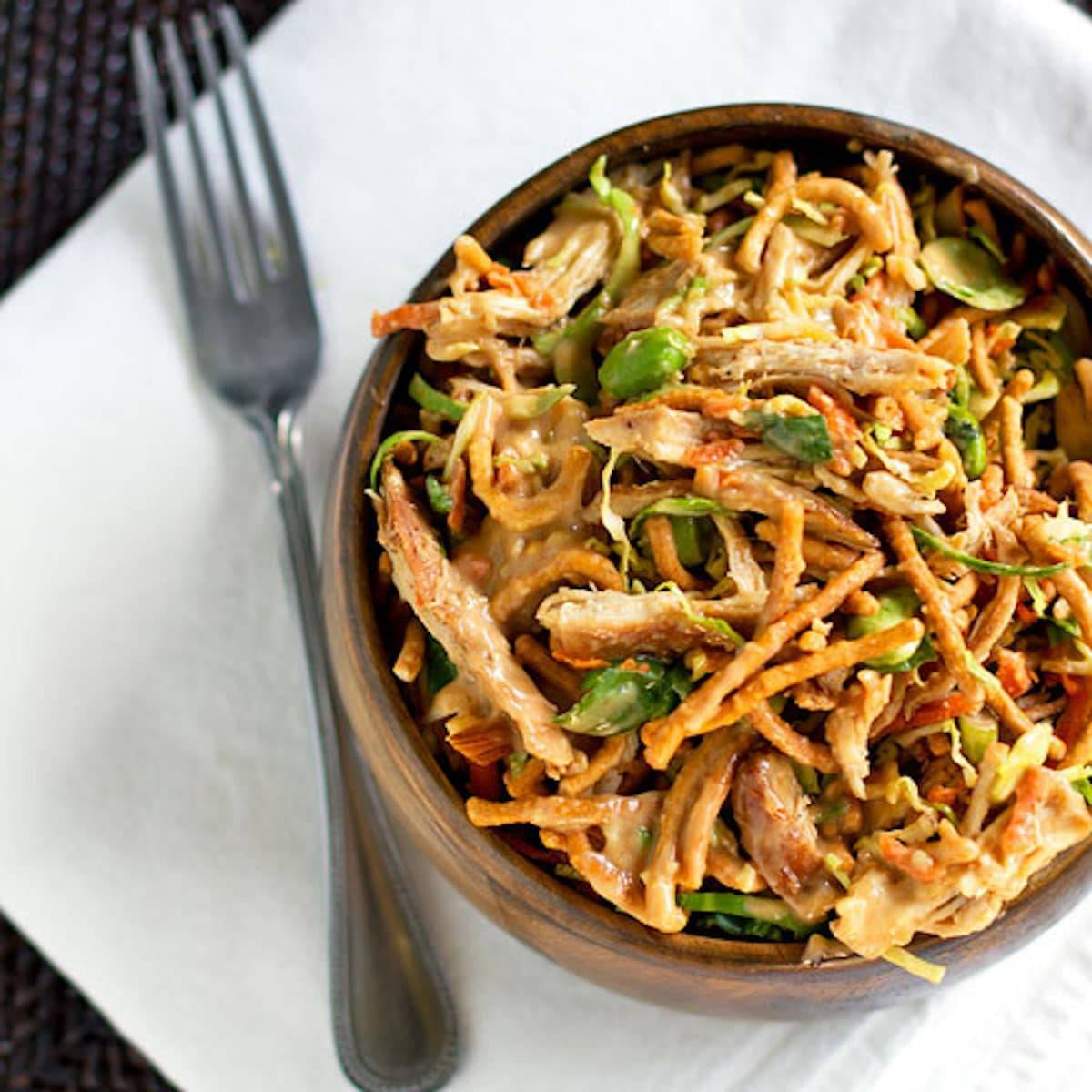 This Asian chicken salad is a healthy favorite in our family! Chow mein noodles, cabbage, edmame, carrots, chicken, marinated chicken, and Asian dressing. | pinchofyum.com