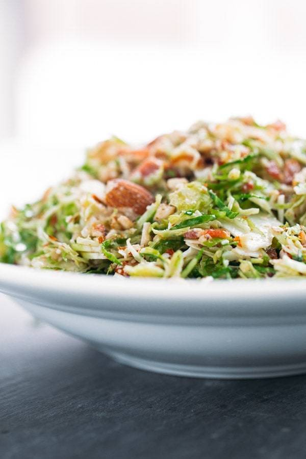 Bacon and Brussels Sprout Salad in a white bowl.